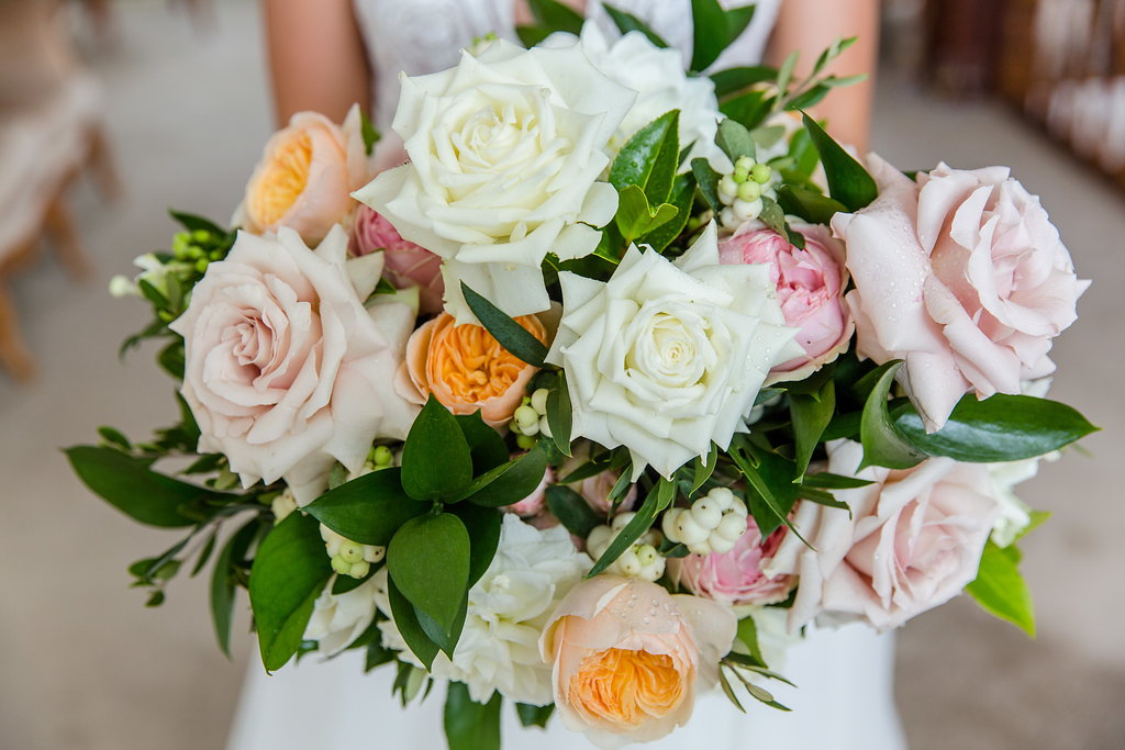 Pastel wedding bouquet featuring antique pink and peach tones