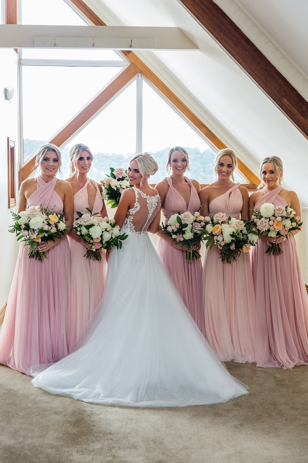 Pastel wedding bouquets featuring antique pink and peach tones