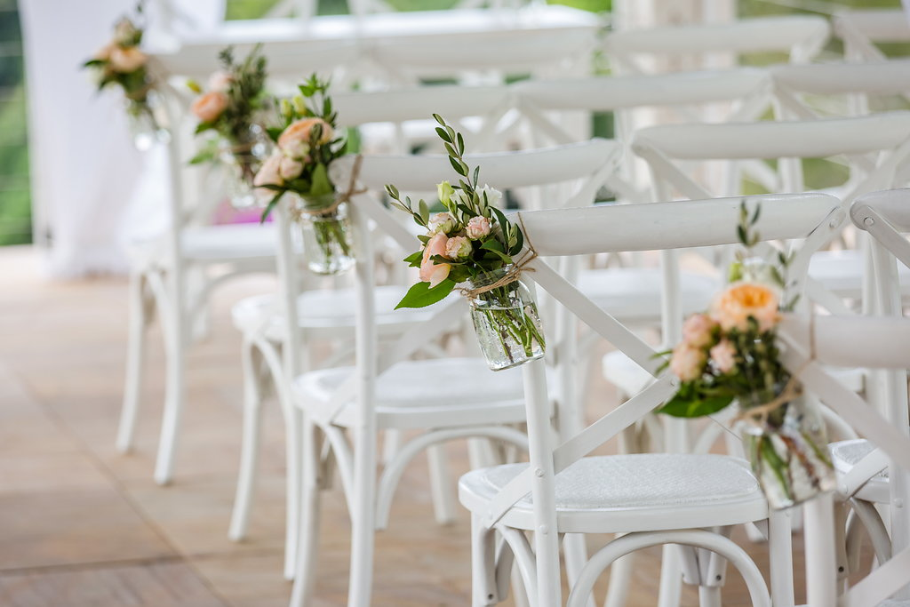 Ceremony chair jars featuring roses