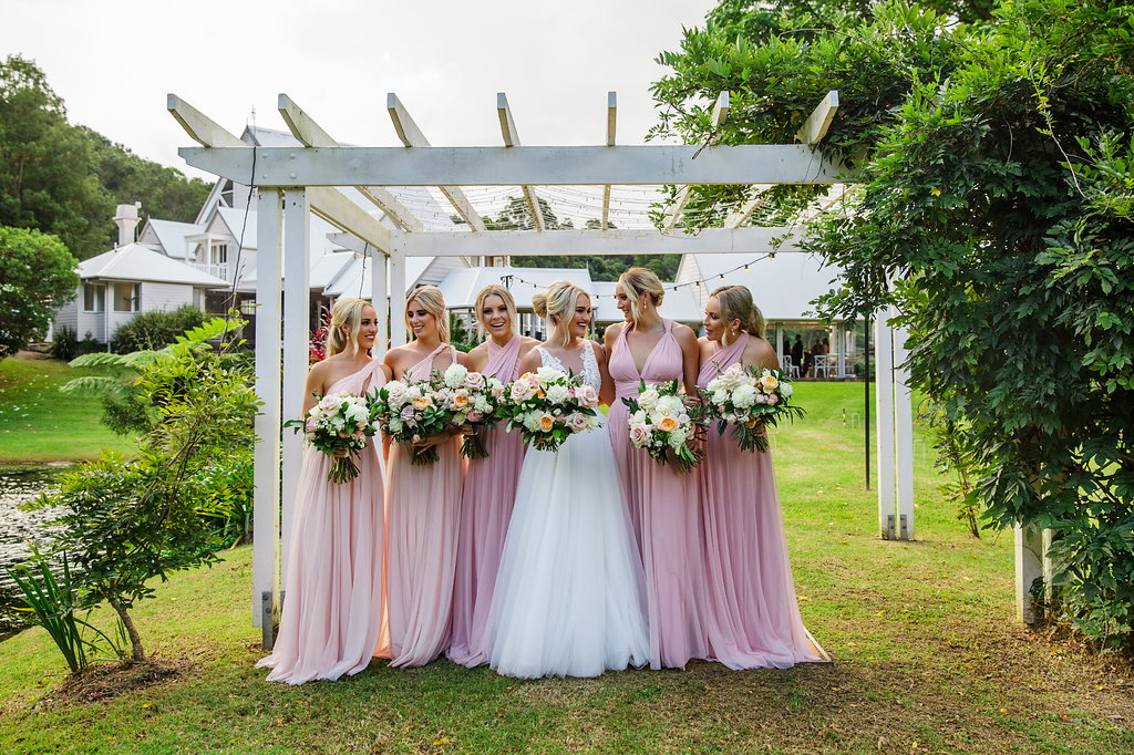 Pretty pastel bridal bouquets featuring apricot David Austin roses