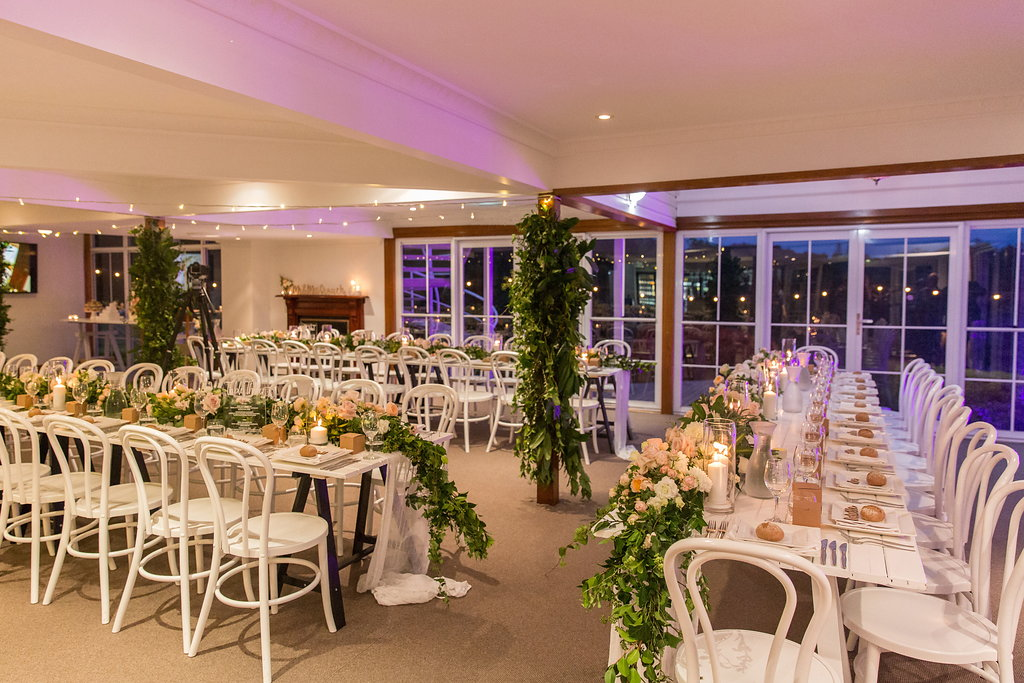 Reception table garlands featuring lush greenery and pastel blooms