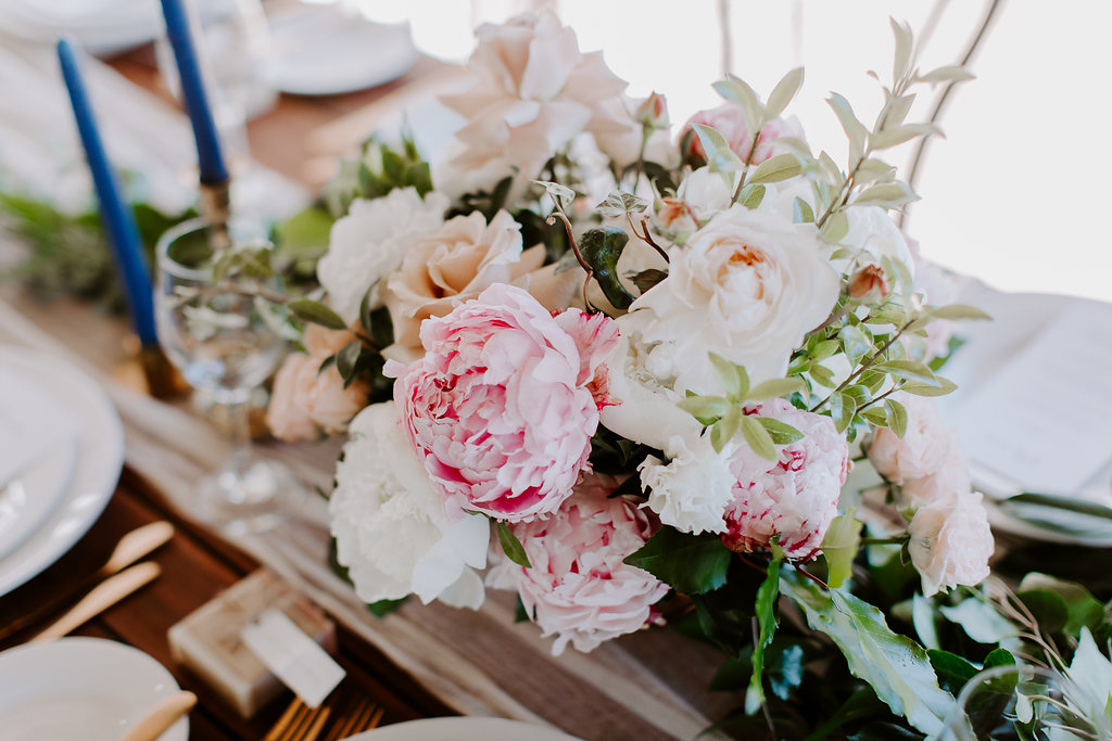 Romantic table centrepieces featuring peonies