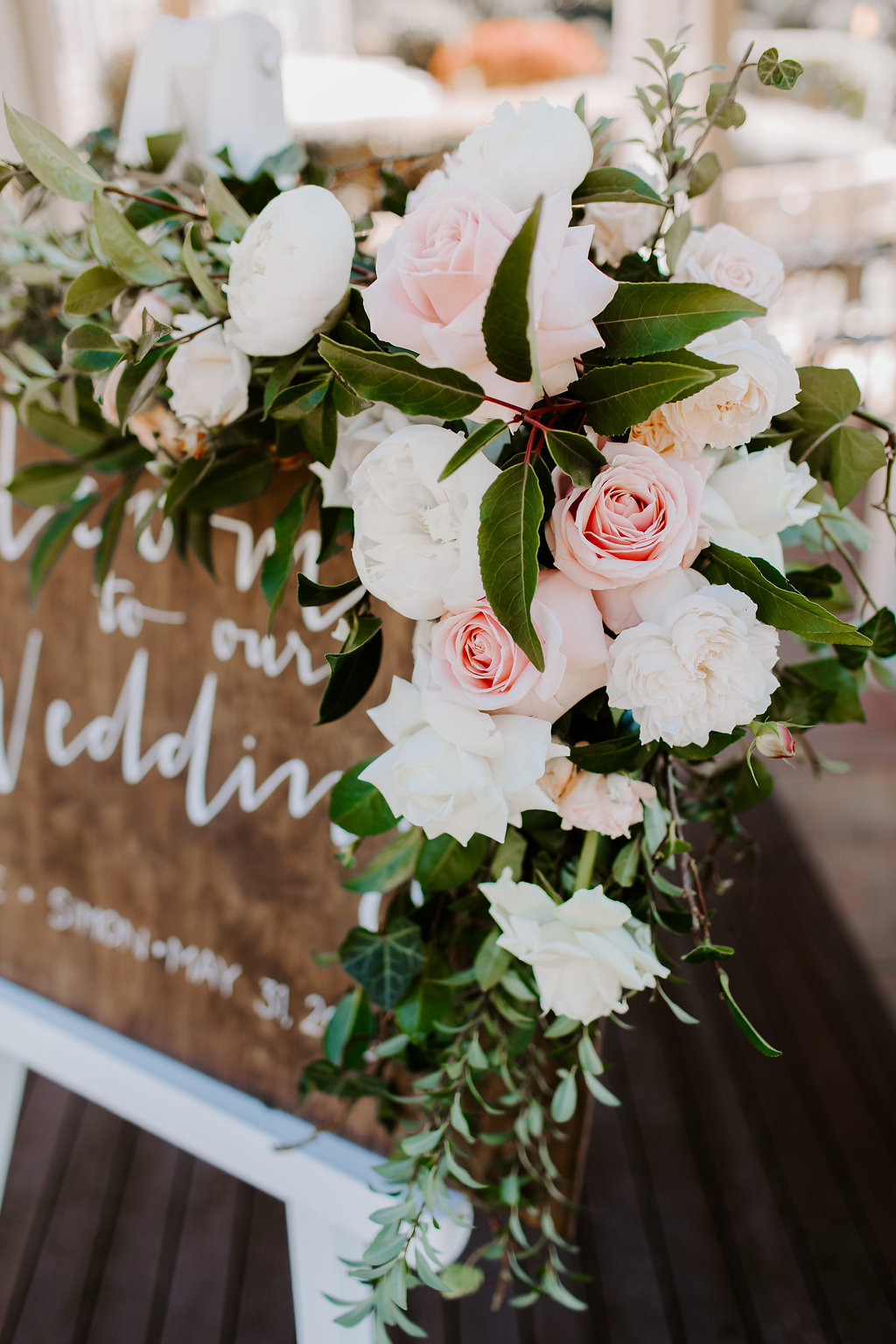 Entry sign floral featuring pastel roses
