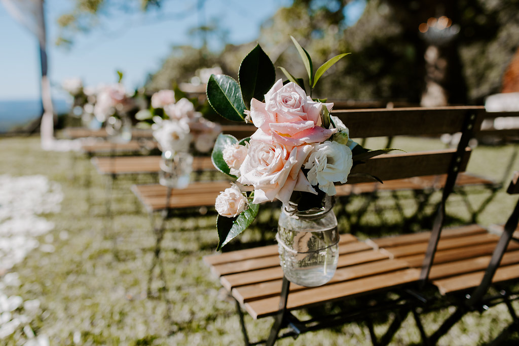 Ceremony chair jars featuring pastel roses