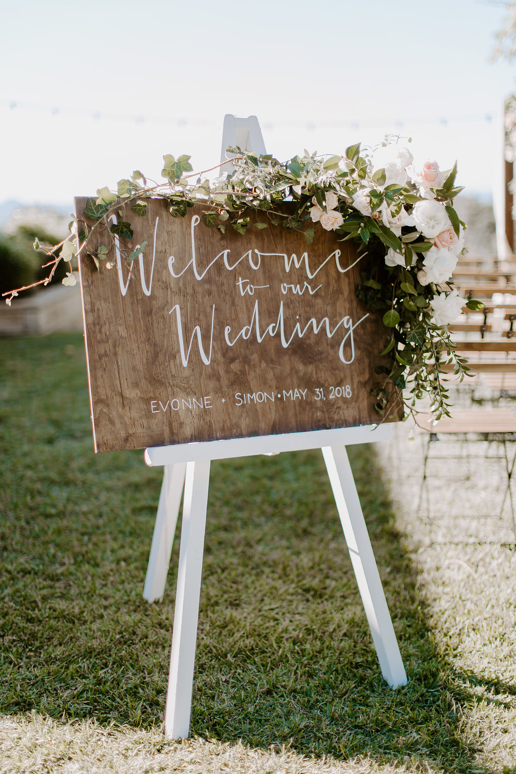 Entry sign floral featuirng peonies roses and greenery