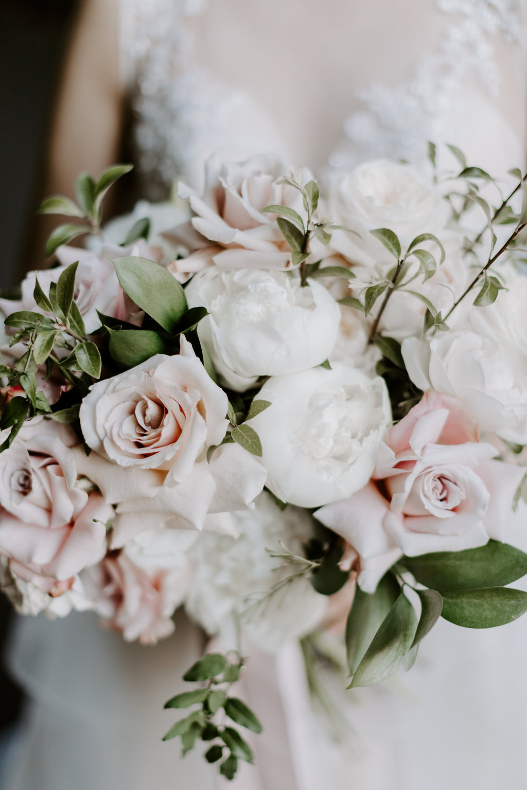 Romantic wedding flowers featuiring peonies and roses