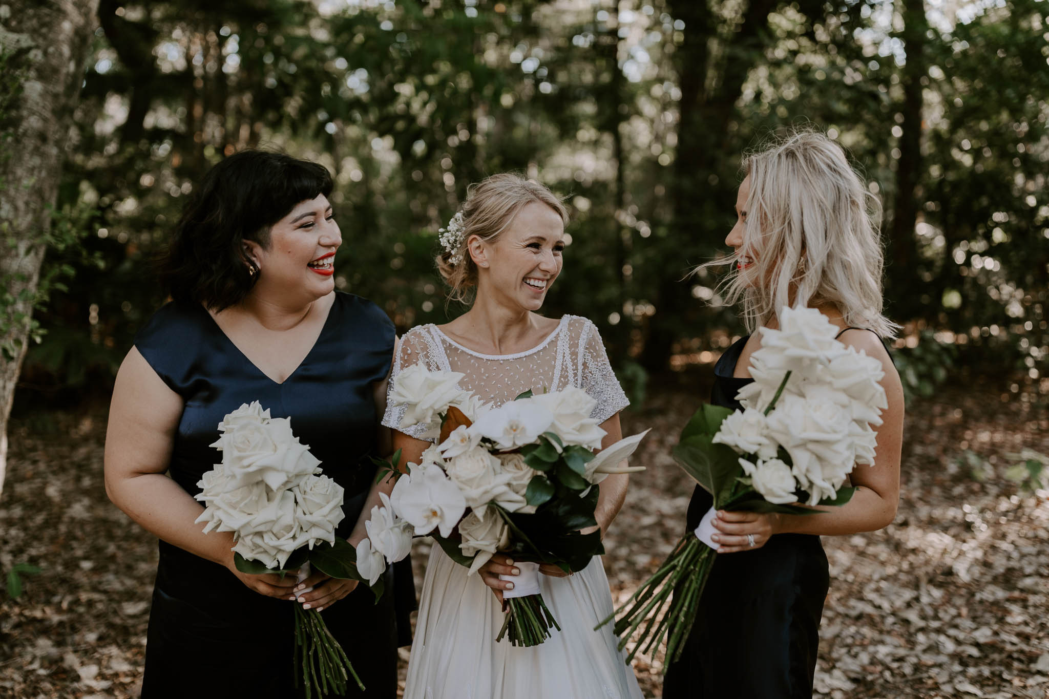 Modern white wedding bouquets featuring roses and orchids