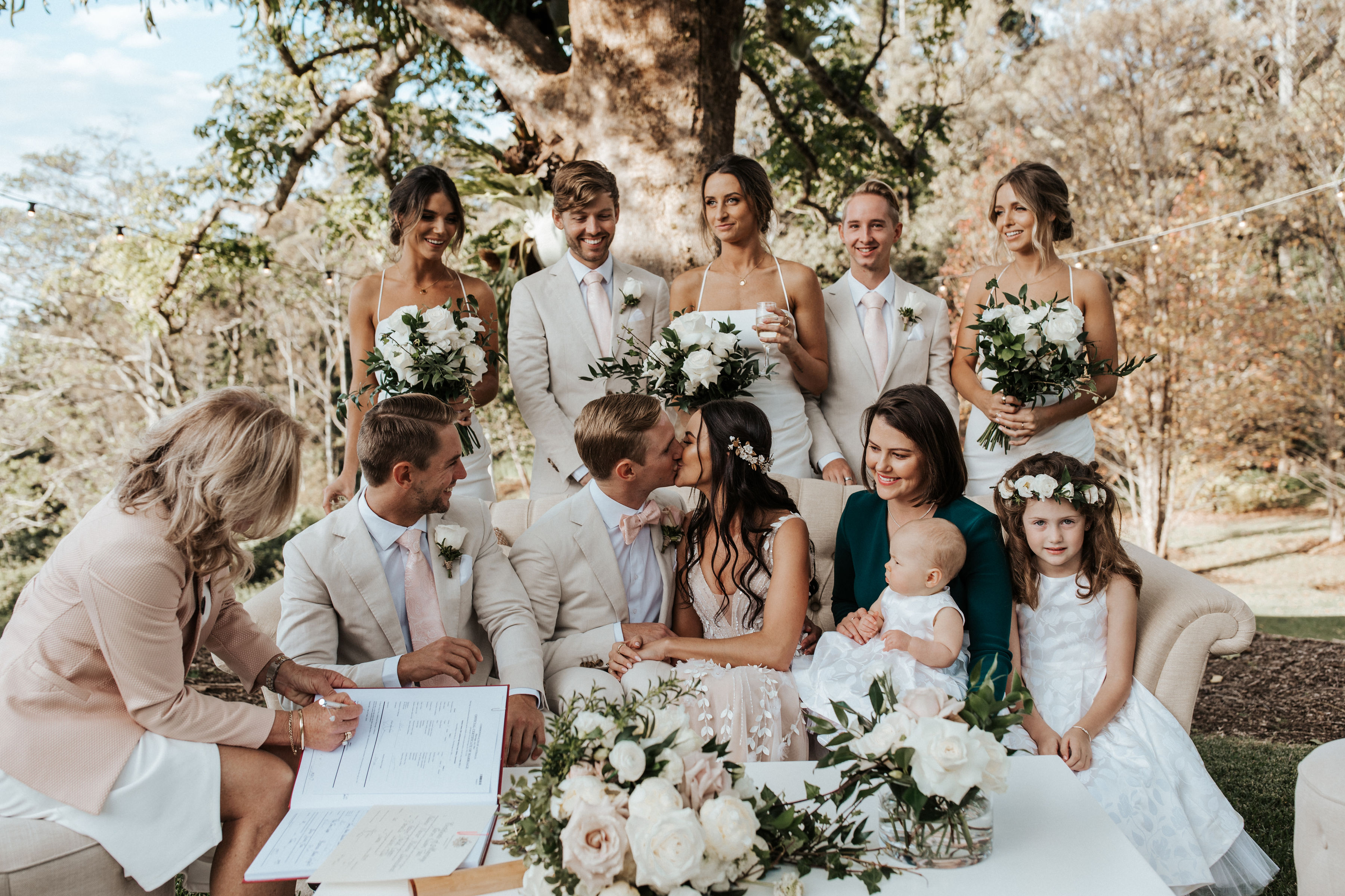 Ceremony on the Helipad in the Hinterlands with Pink and White Wedding Flowers