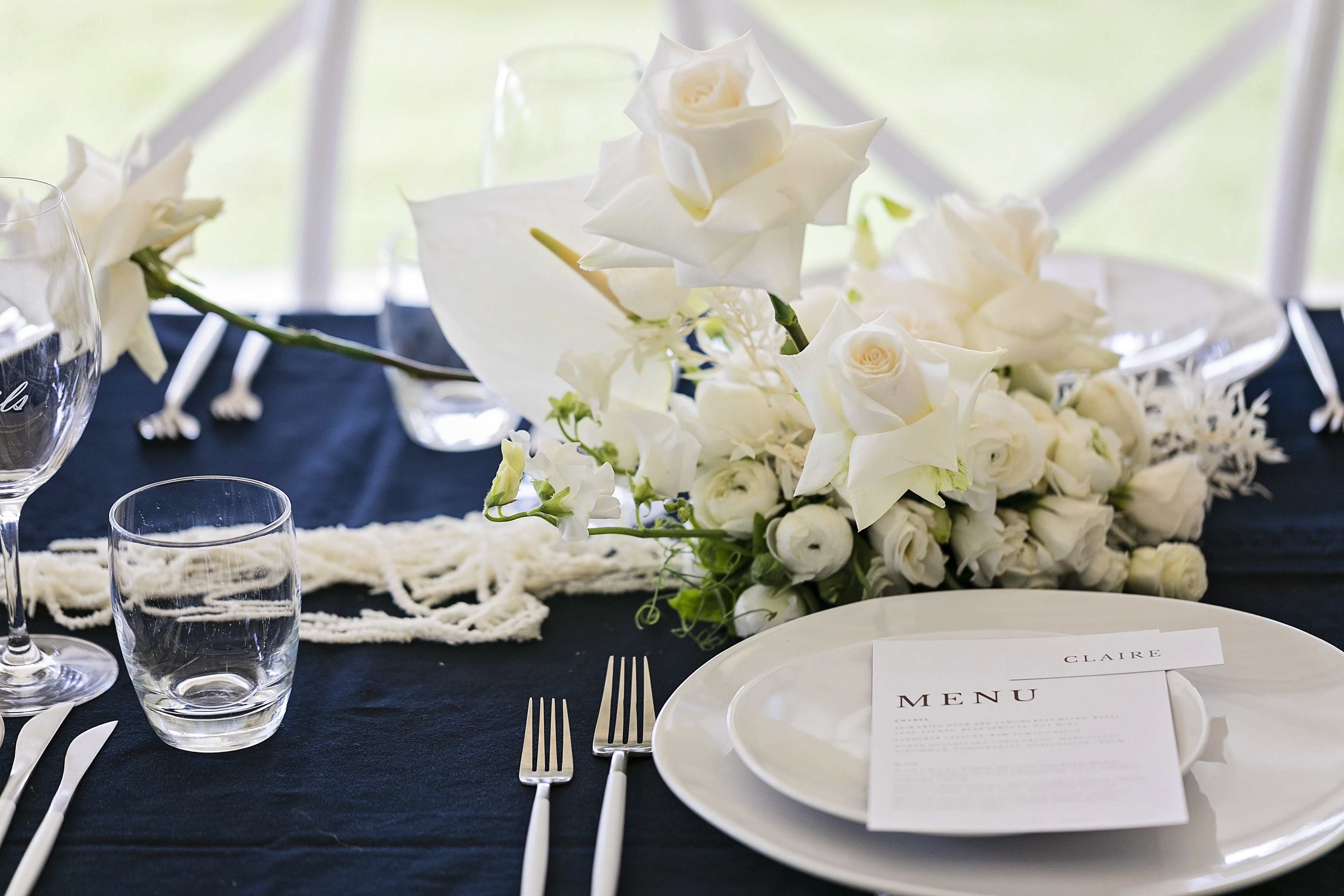 Costal style blooms of roses in orchids with navy styling touches