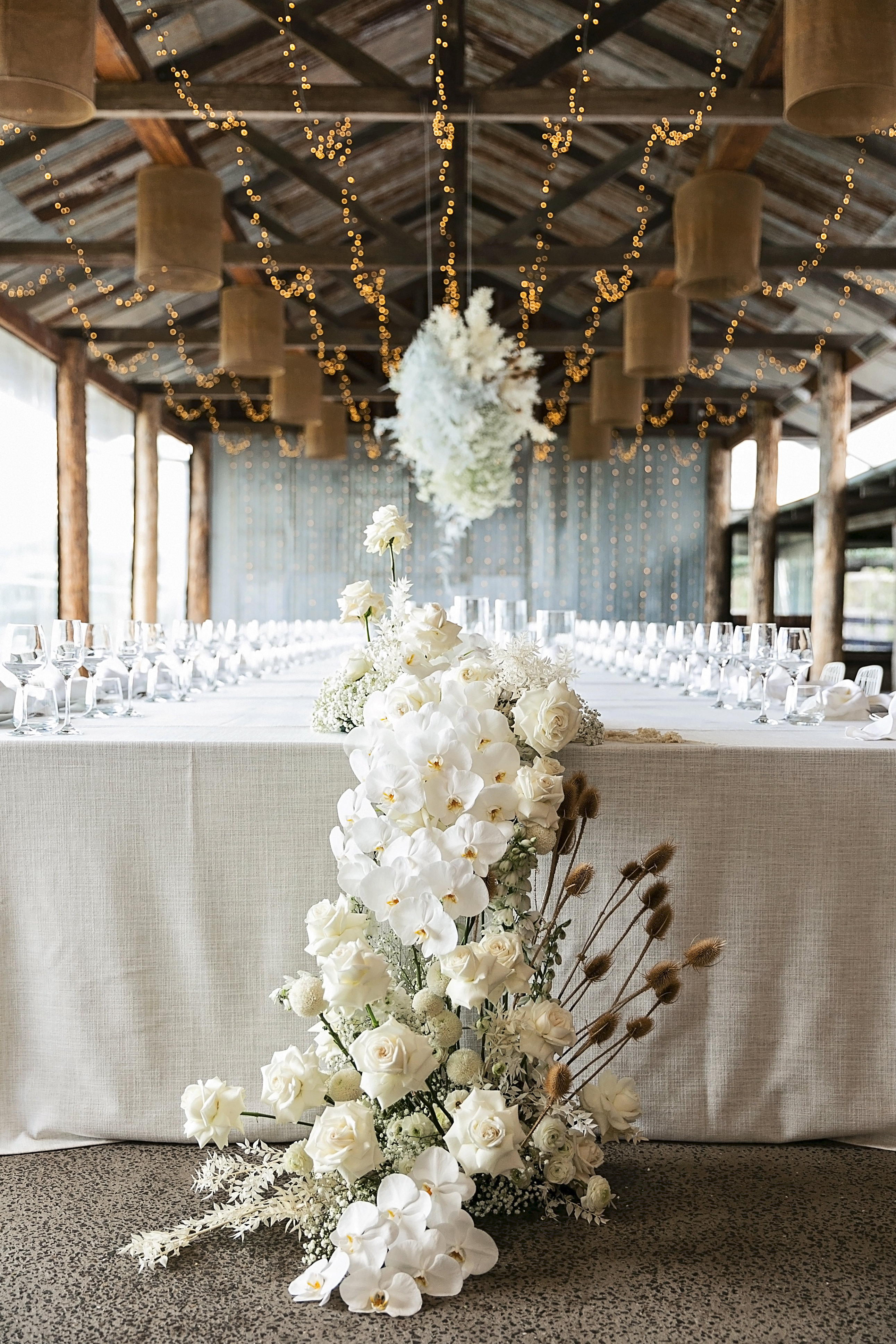 Modern White Wedding Style with Babies Breath, Phalaenopsis Orchids, Roses and Dried Flowering Filler