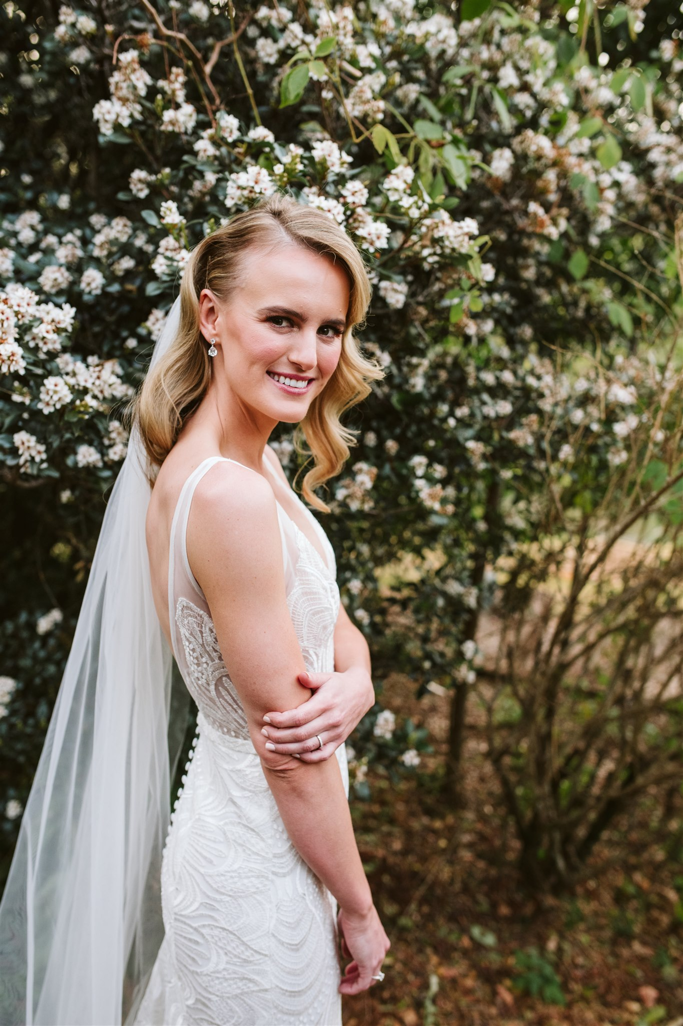 White Wedding Blooms With Dark Lush Greenery Accents