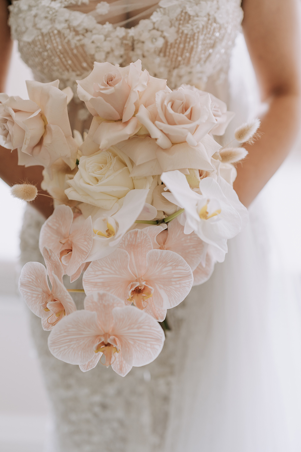Modern wedding bouquet featuring orchids and roses