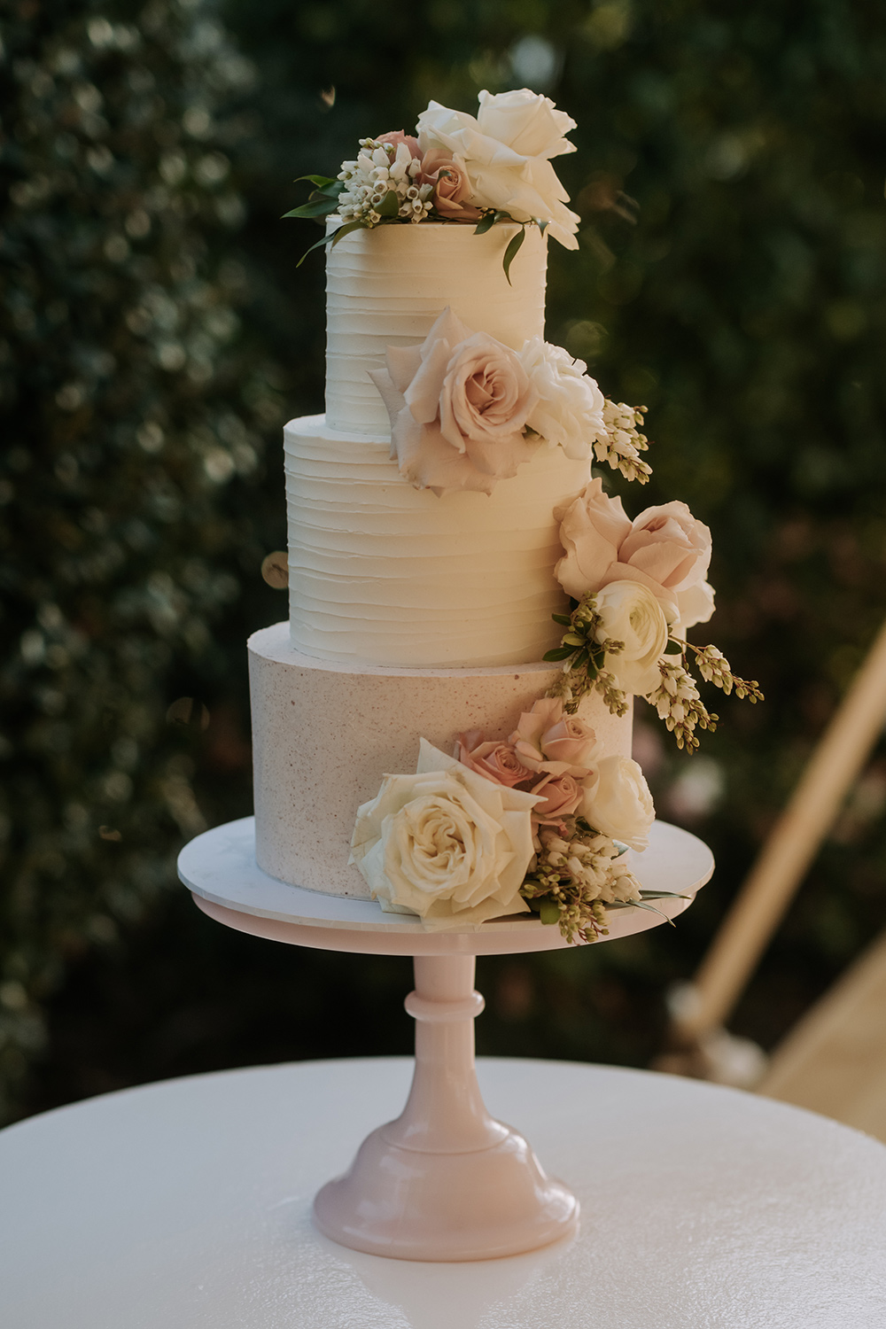 Wedding cake floral featuring including roses