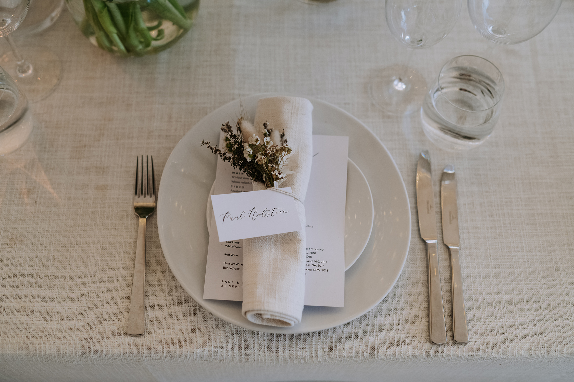 Gathered napkin features with dried flowers