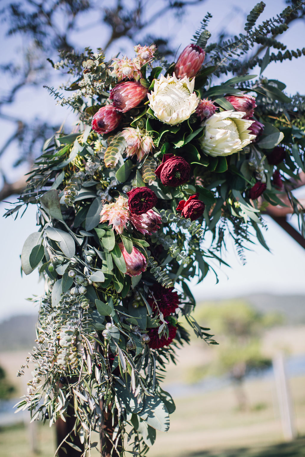 Native Flowers with Rustic Gum and Olive Leaf Foliage