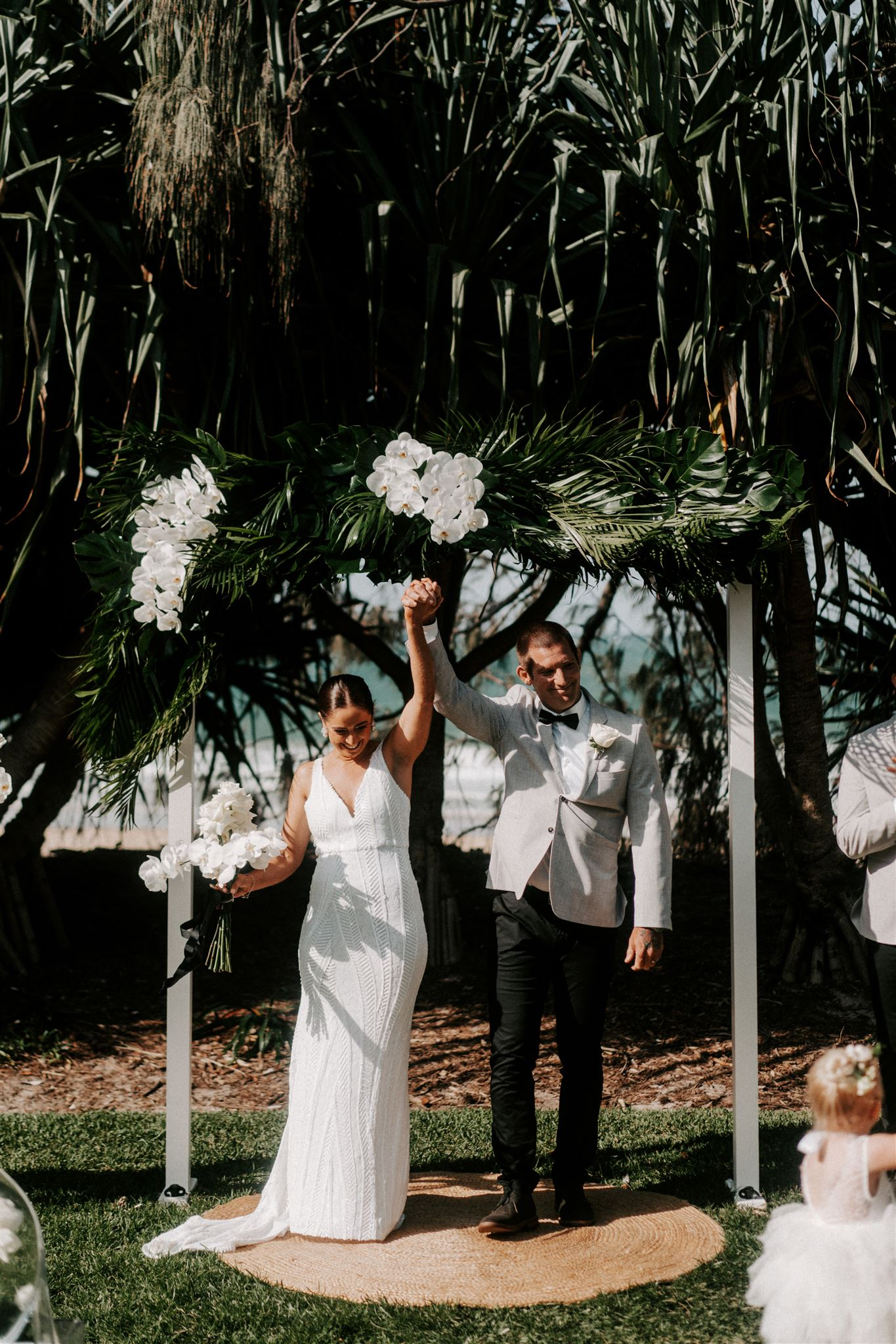 Ceremony arbour featuring tropical leaves