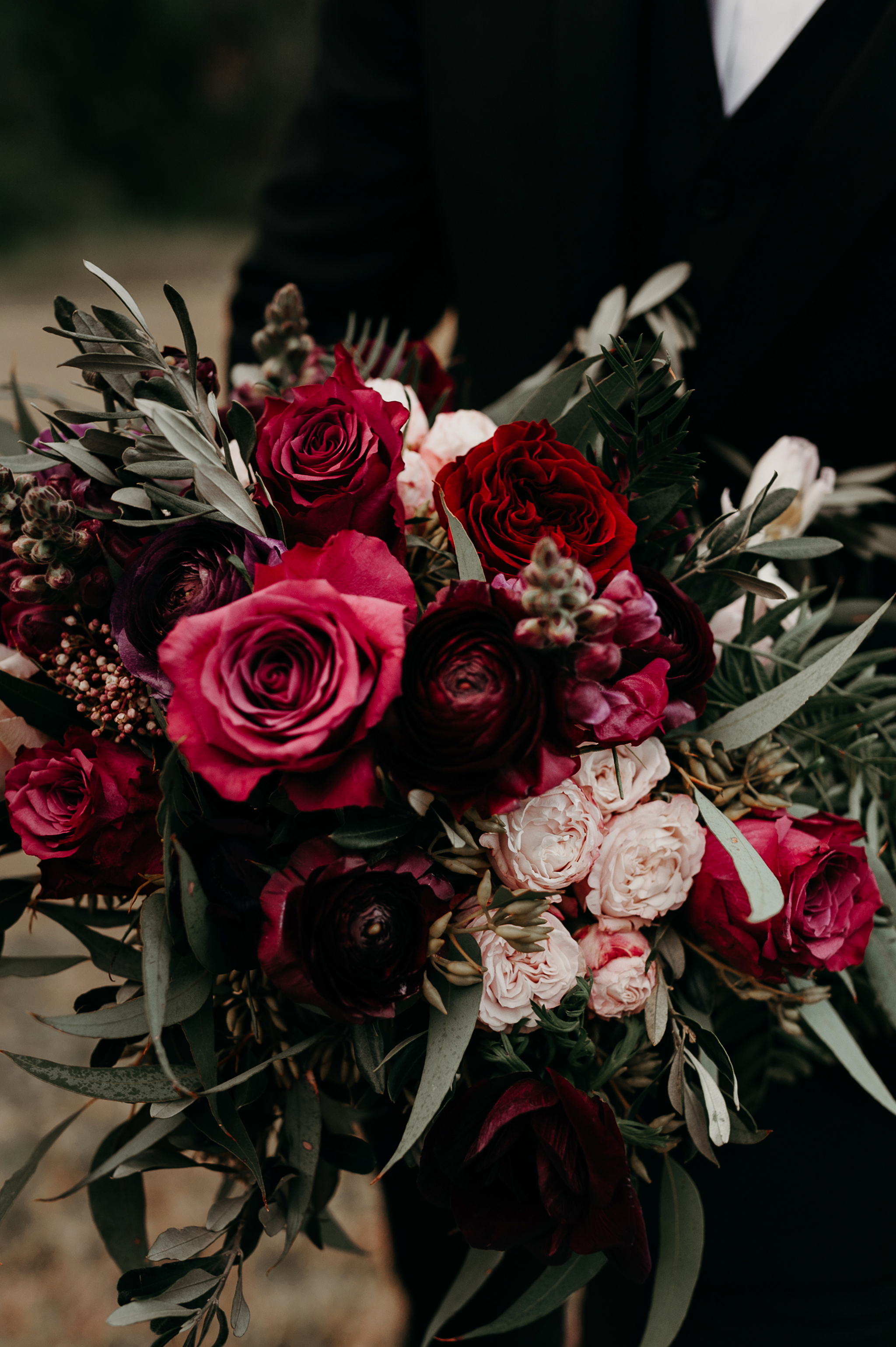 Rustic wedding bouquet in rich ruby tones