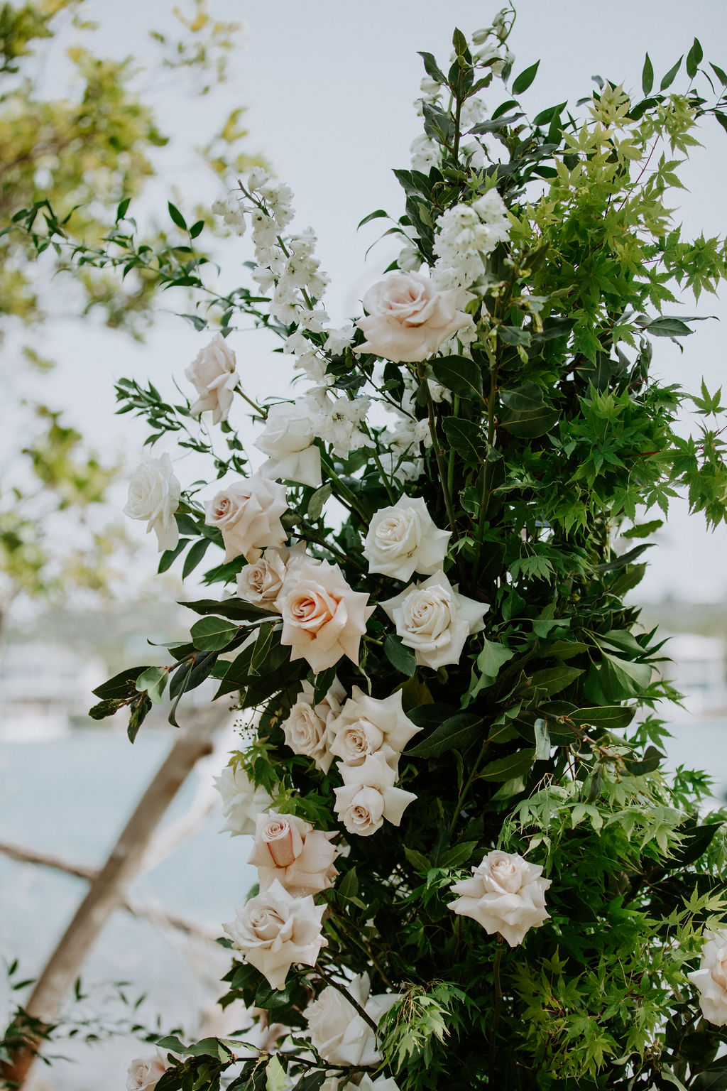 Antique Pink Blooms With White Roses and Dark Lush Greenery