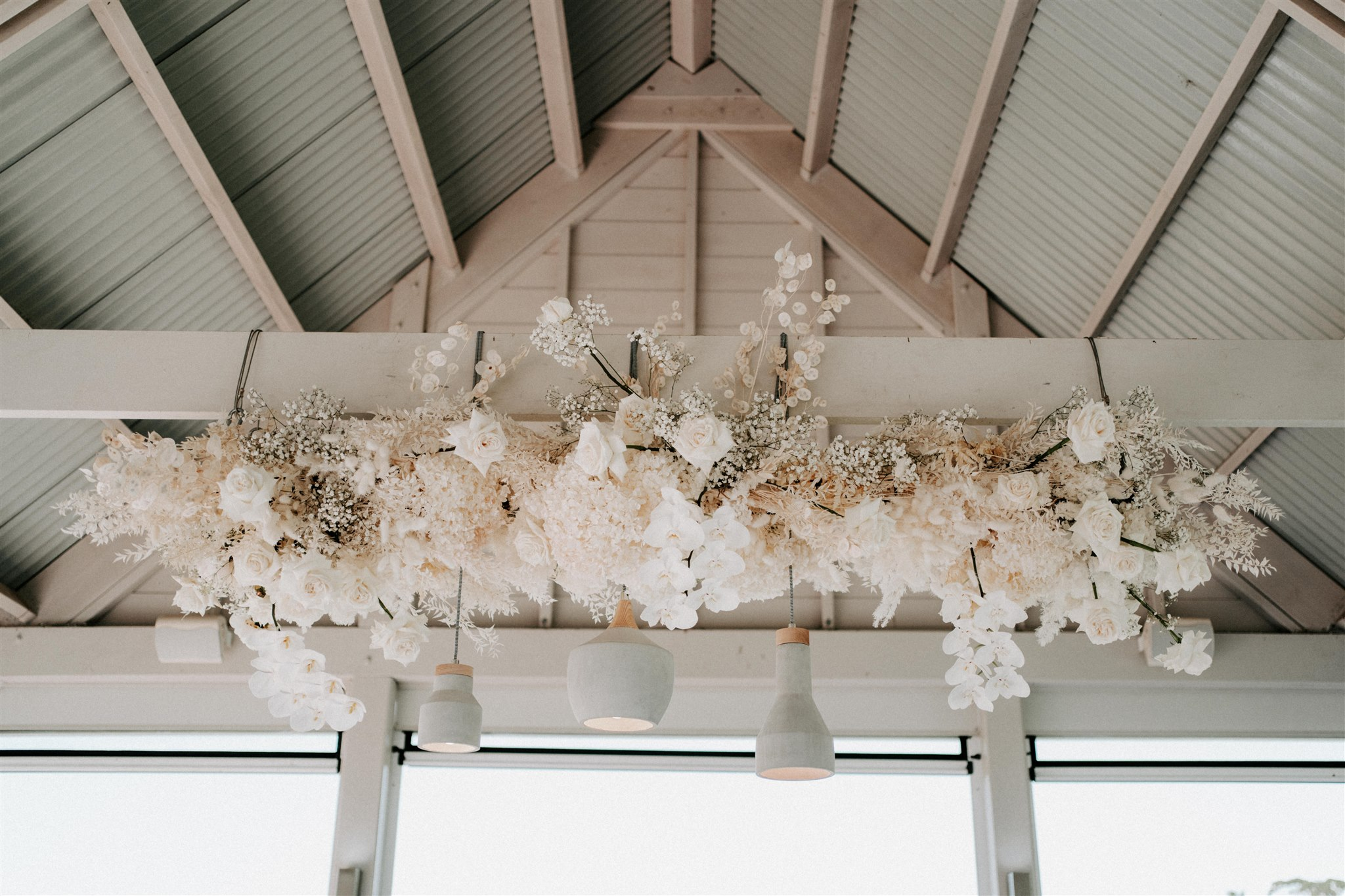 Hanging installation feature orchids and textured elements