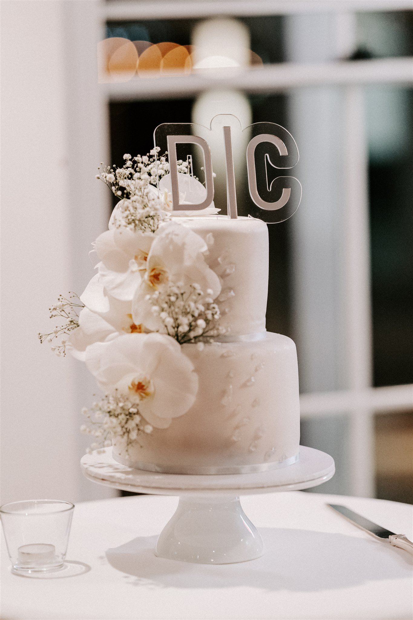 Wedding cake featuring orchids and baby's breath