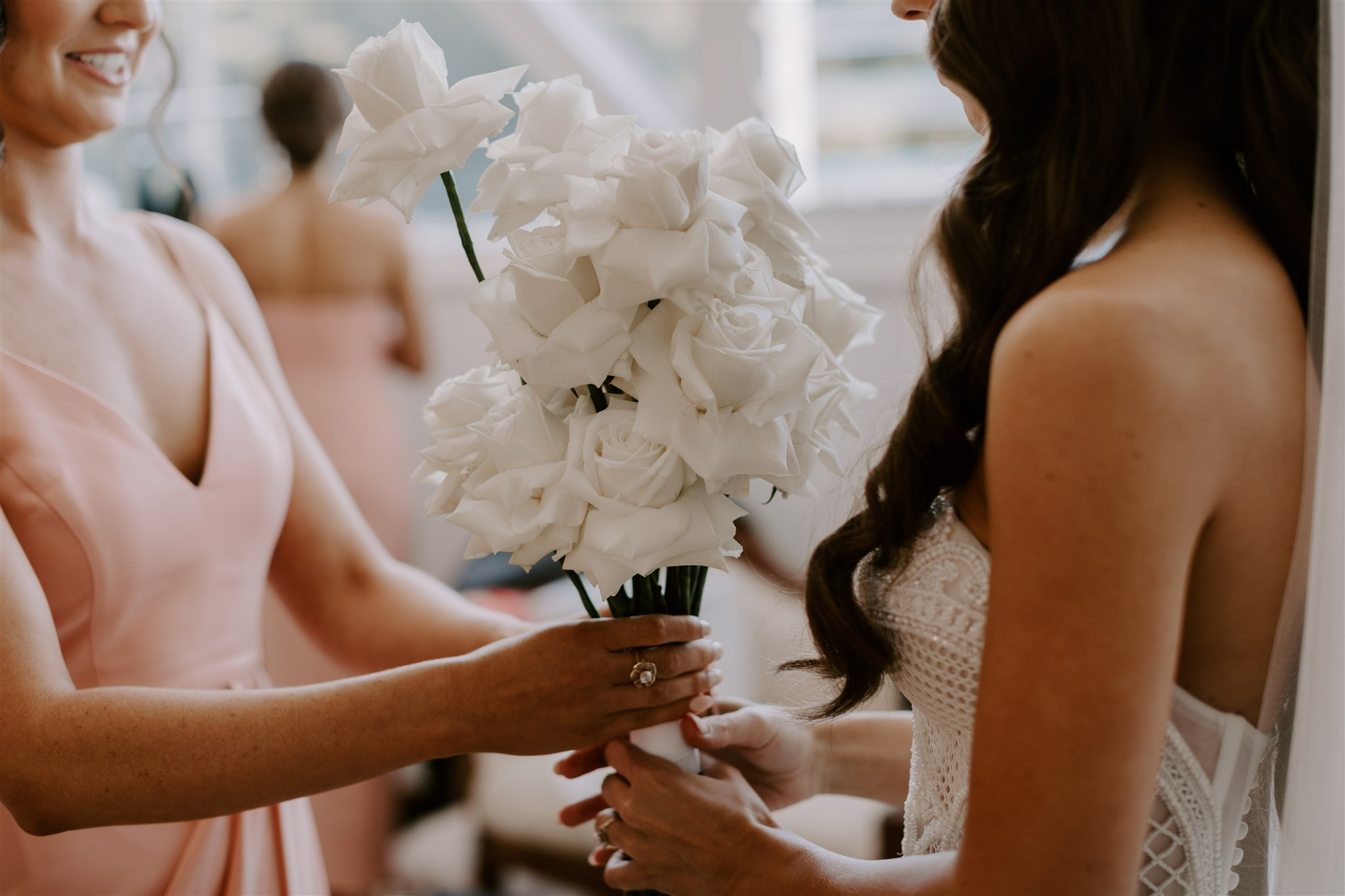Modern white wedding bouquet featuring roses