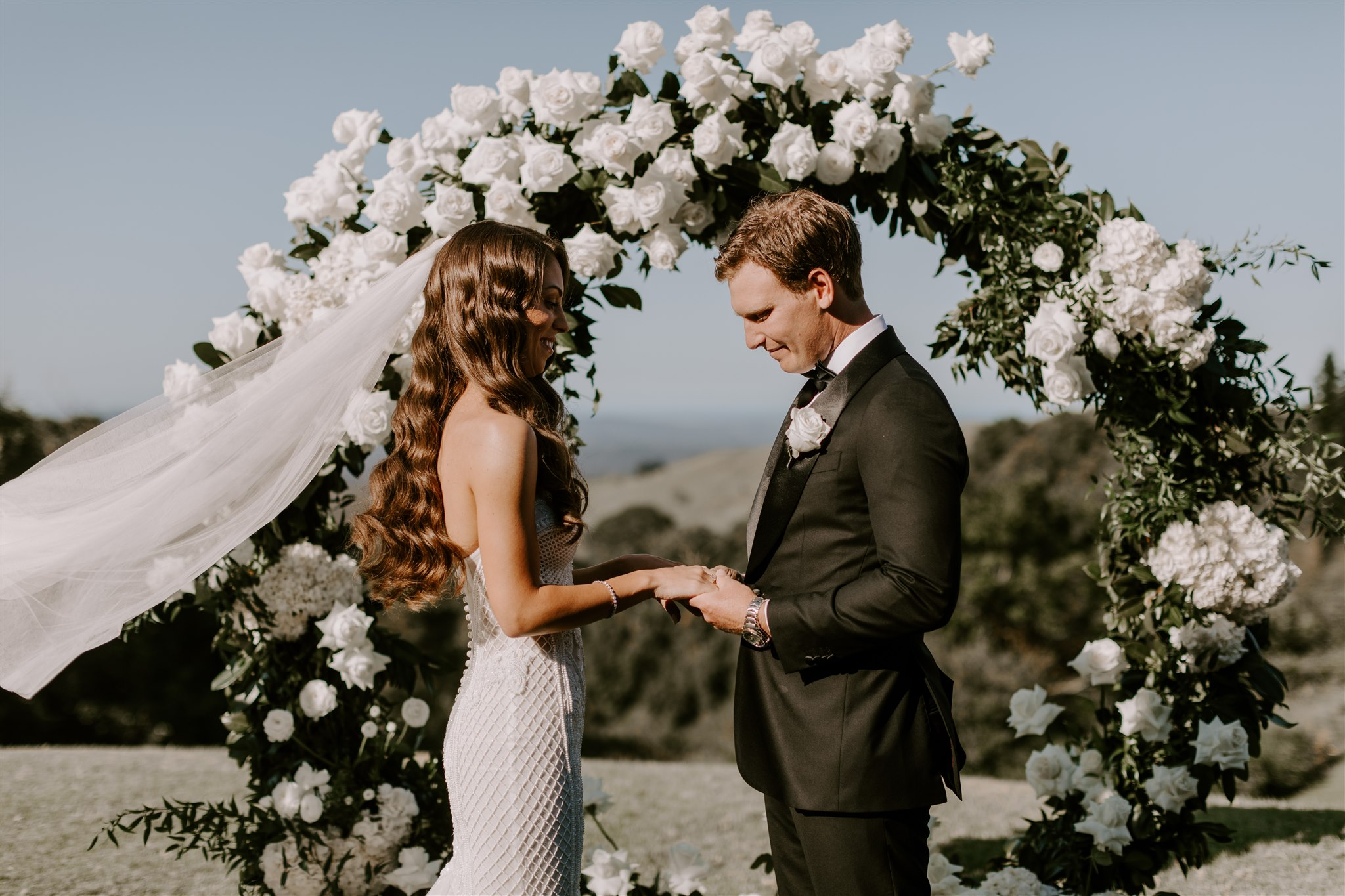 Ceremony love ring with lush greenery and white flowers