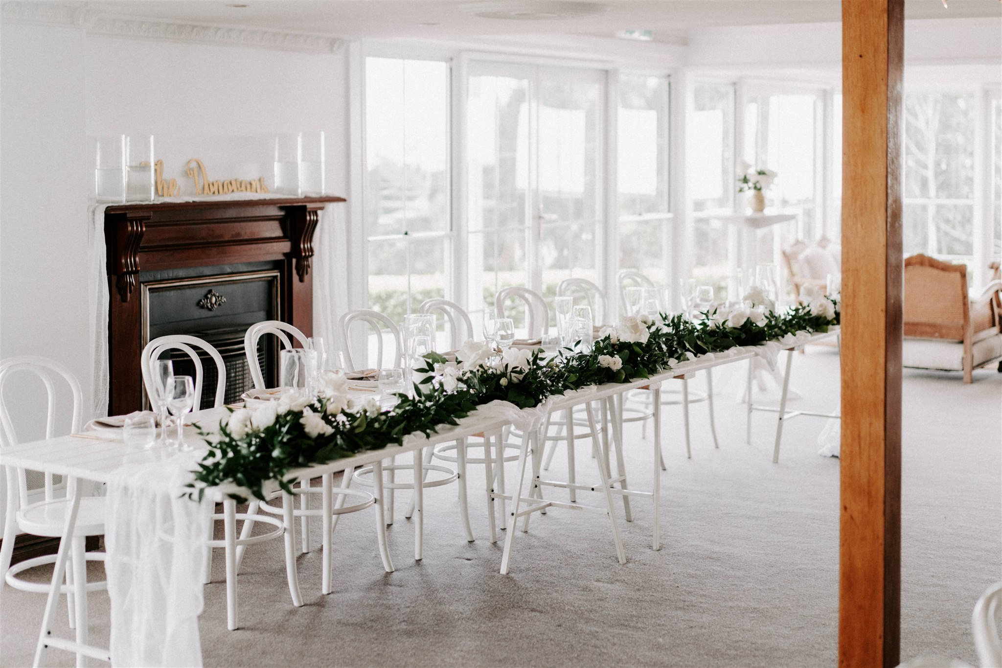 Reception table garlands with lush green foliage