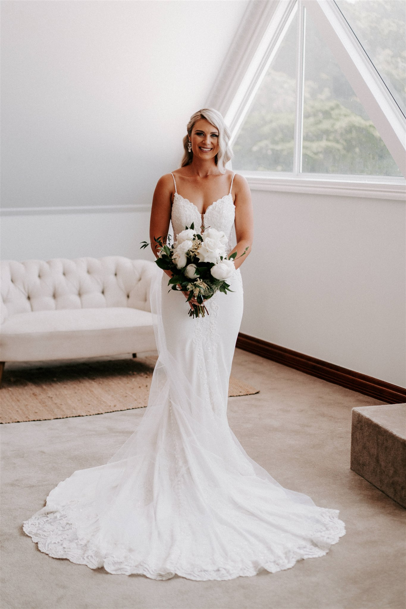 White and green wedding bouquet featuring roses