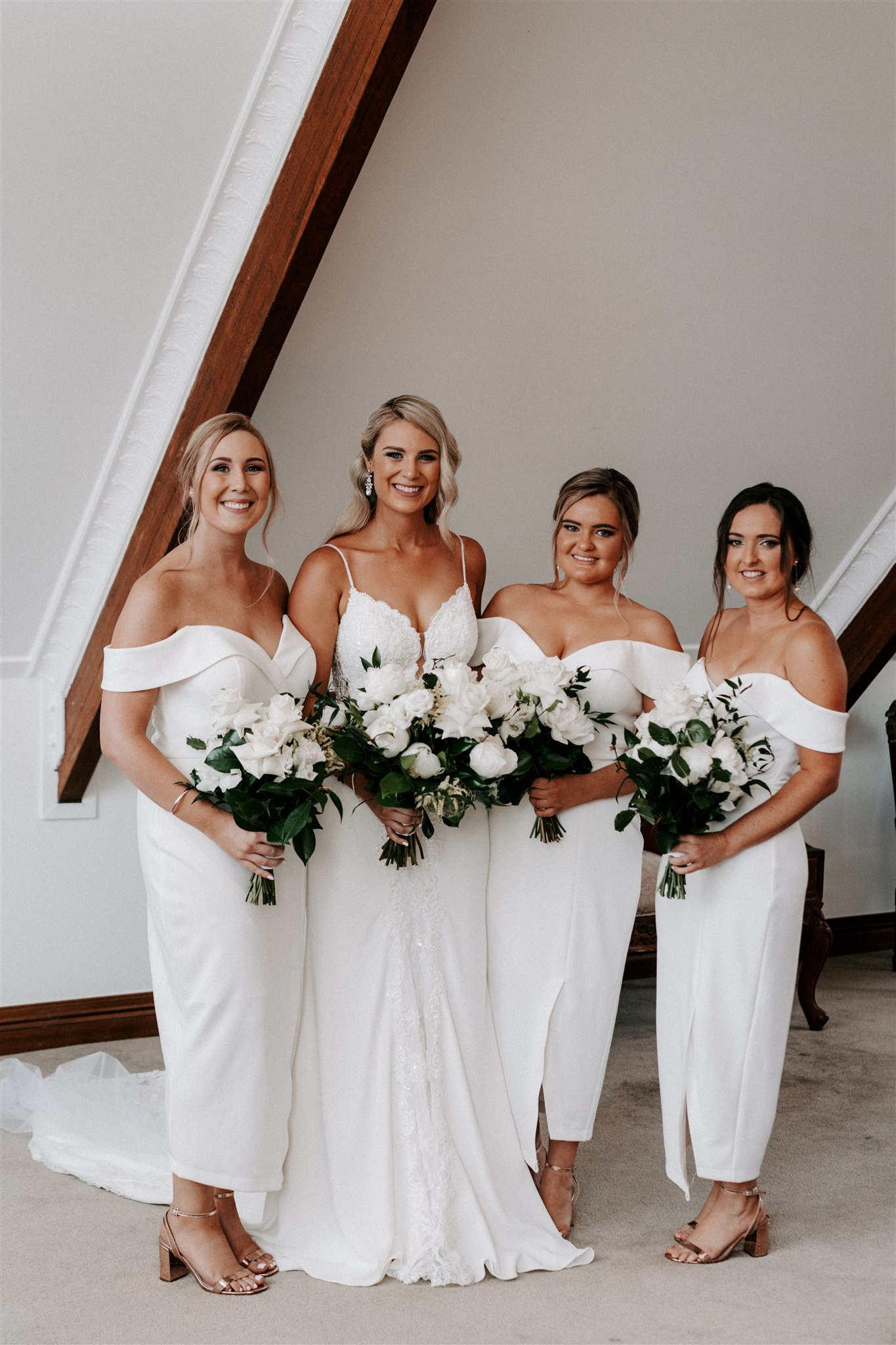 White and green wedding bouquets featuring roses