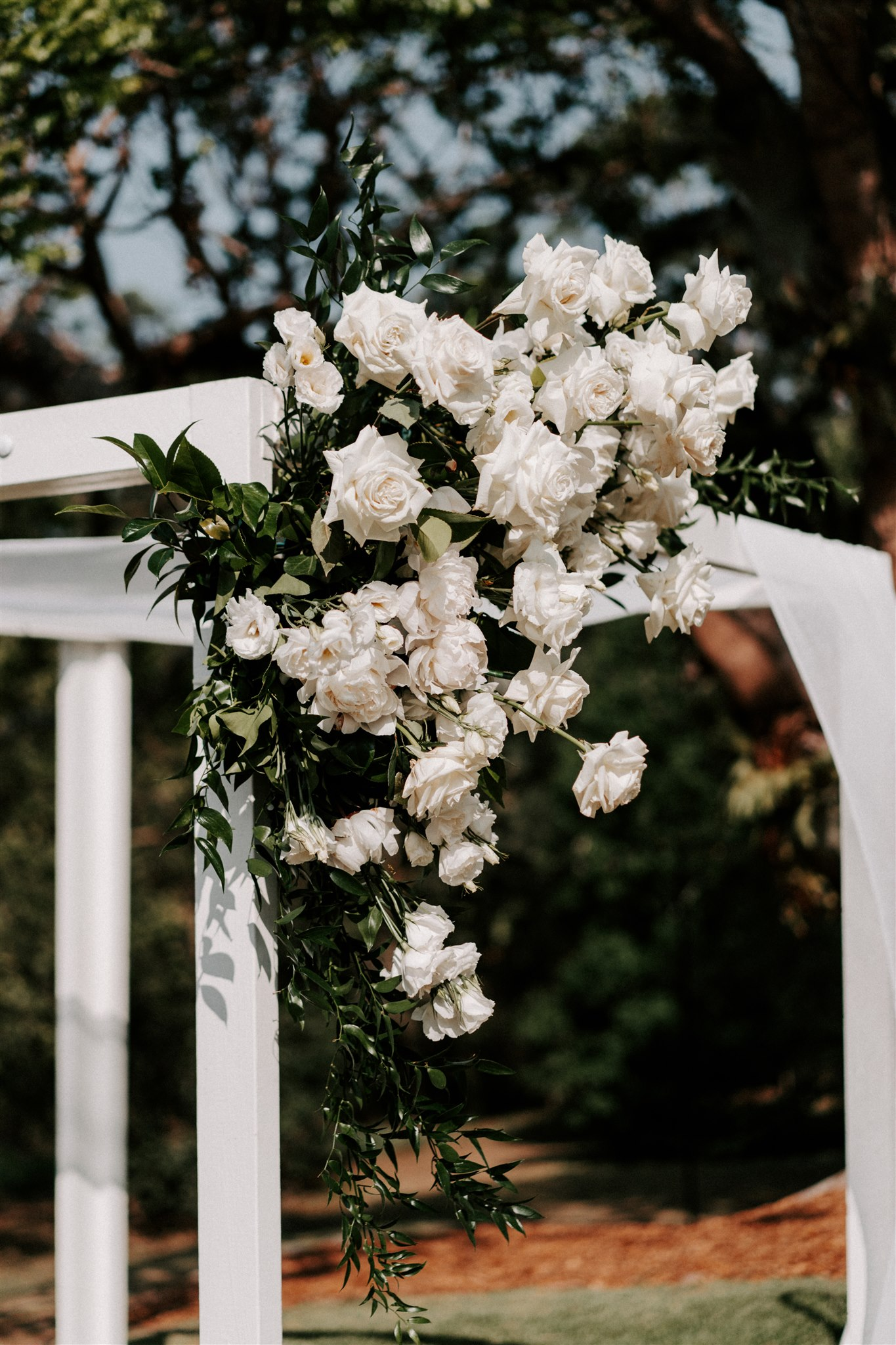 Corner arbour floral feature in white and green tones