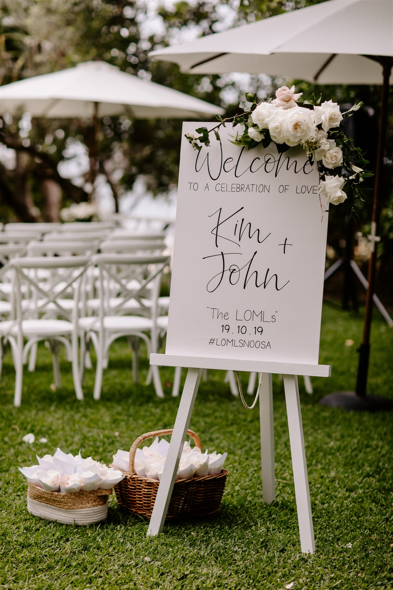 Entry sign florals in white and antique pink tones