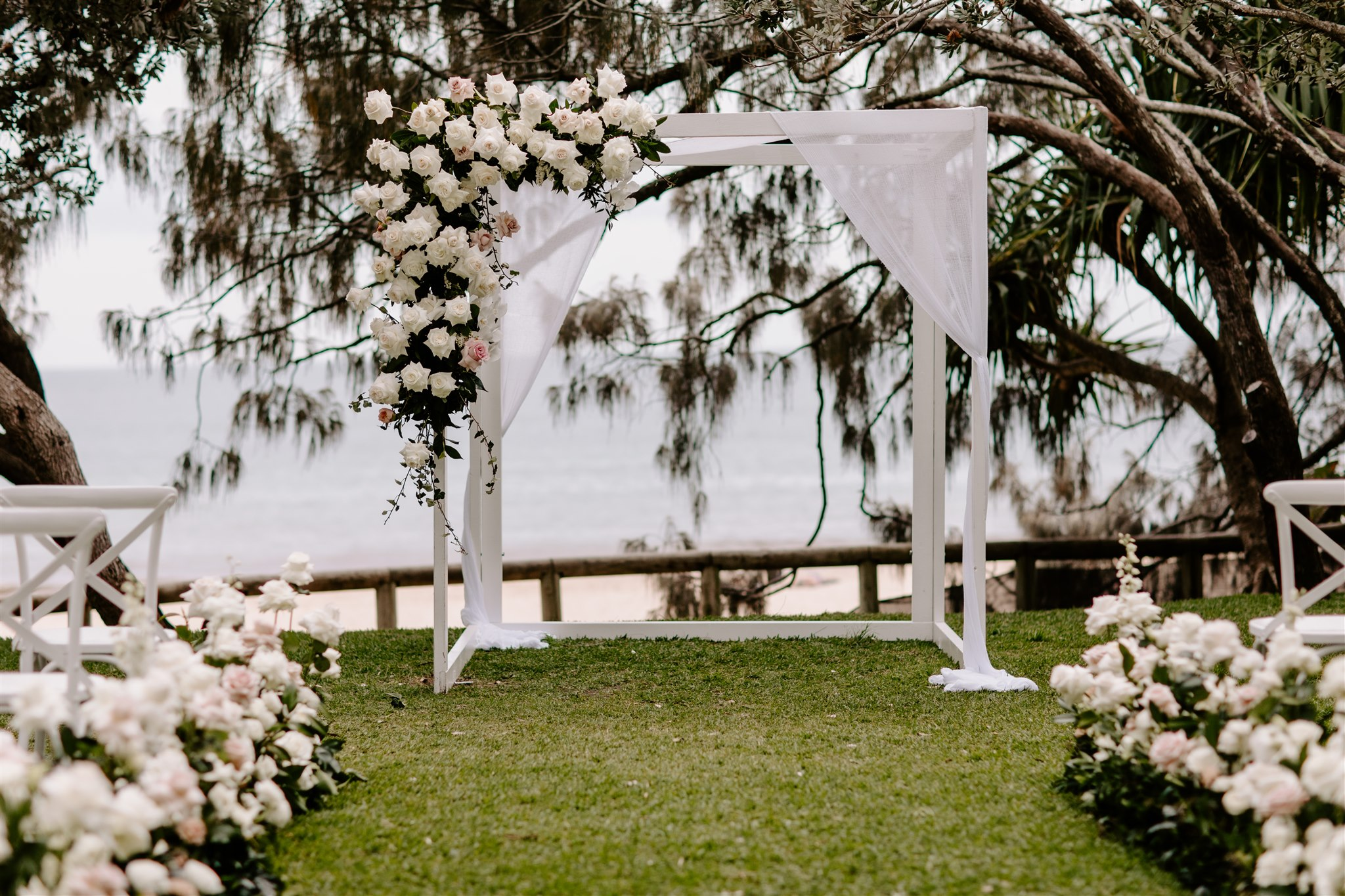Ceremony arbour floral feature with roses