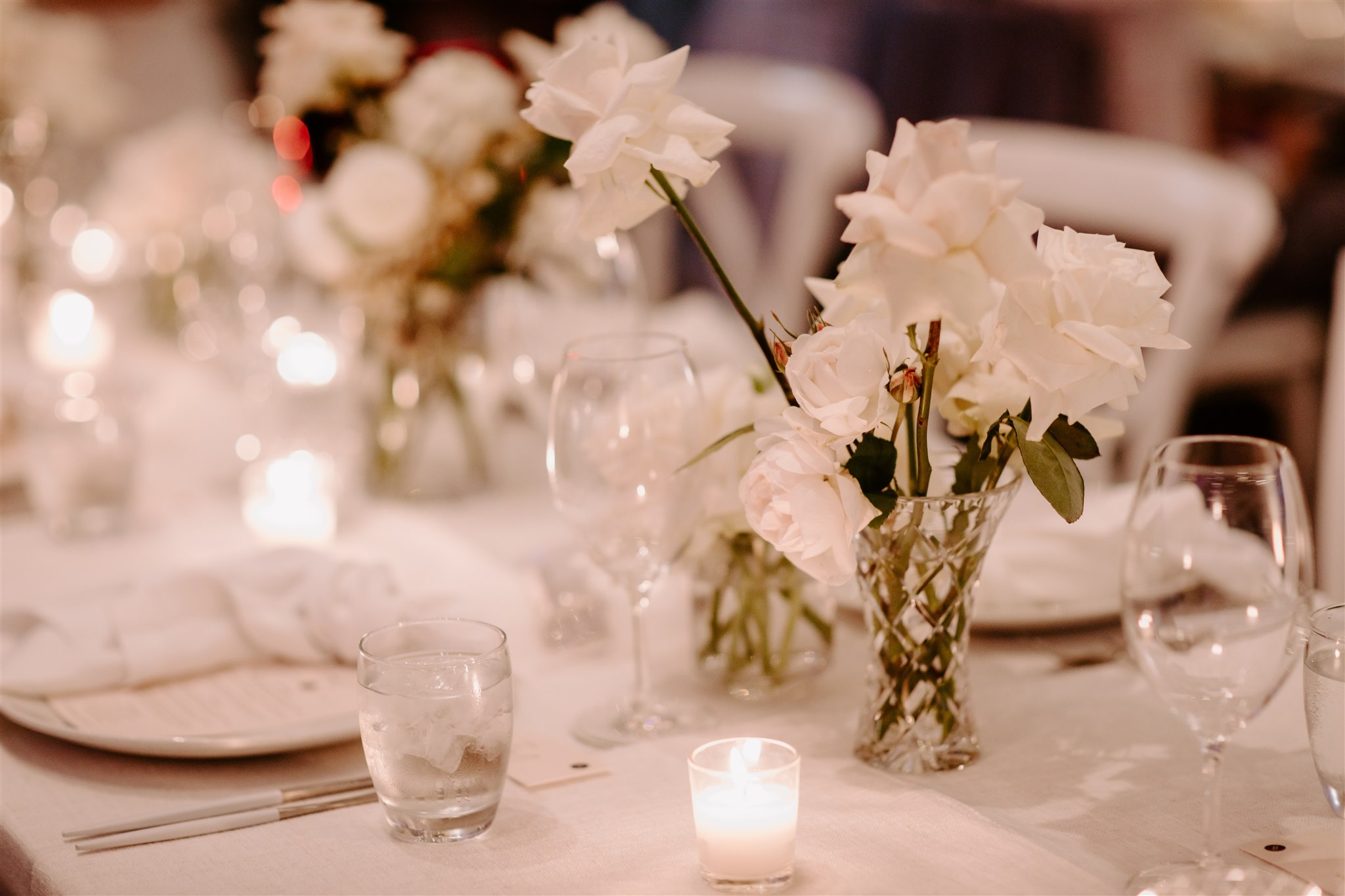 Crystal reception vases with white roses