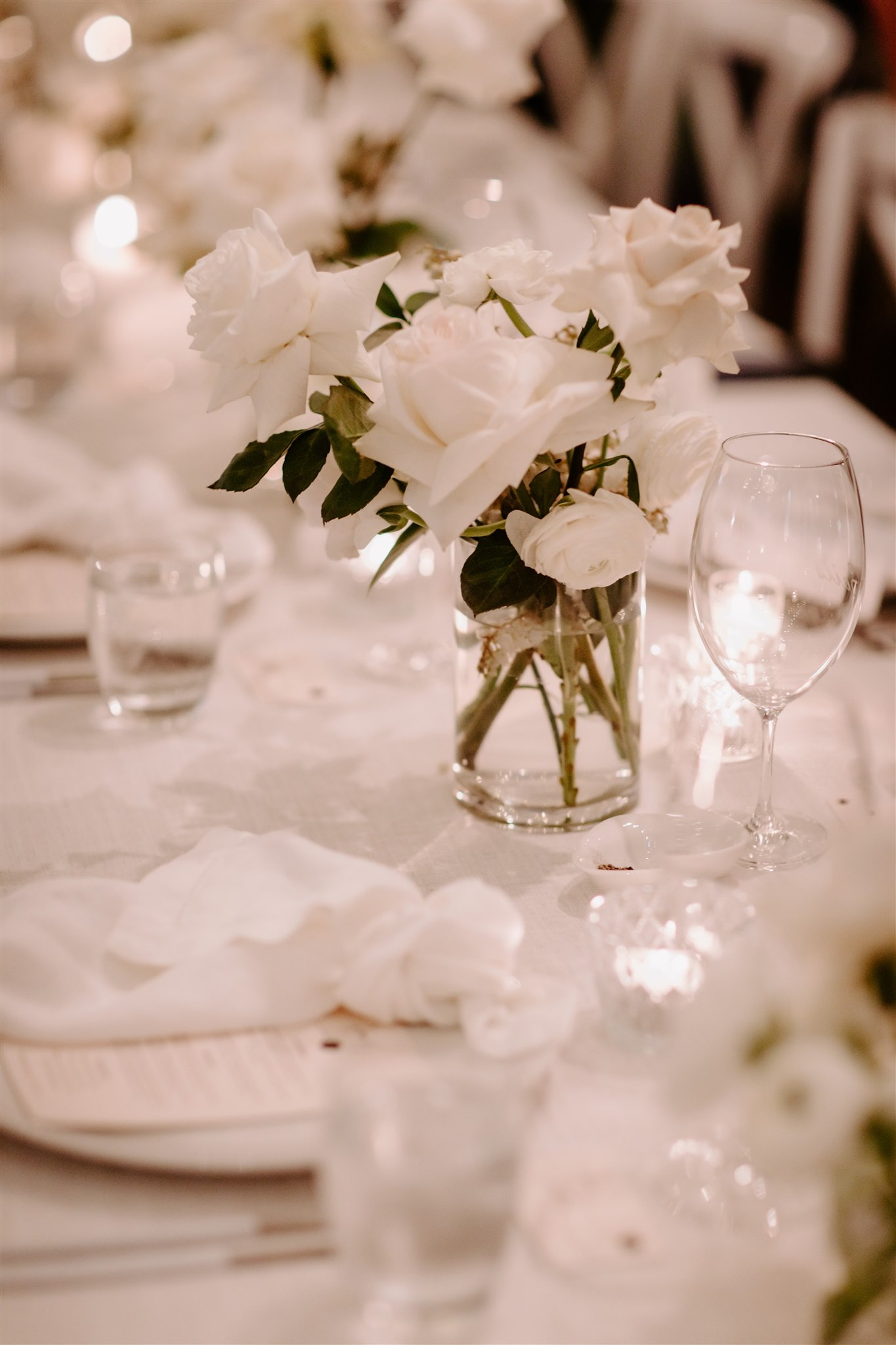 Contemporary glass and crystal vases featuring white blooms