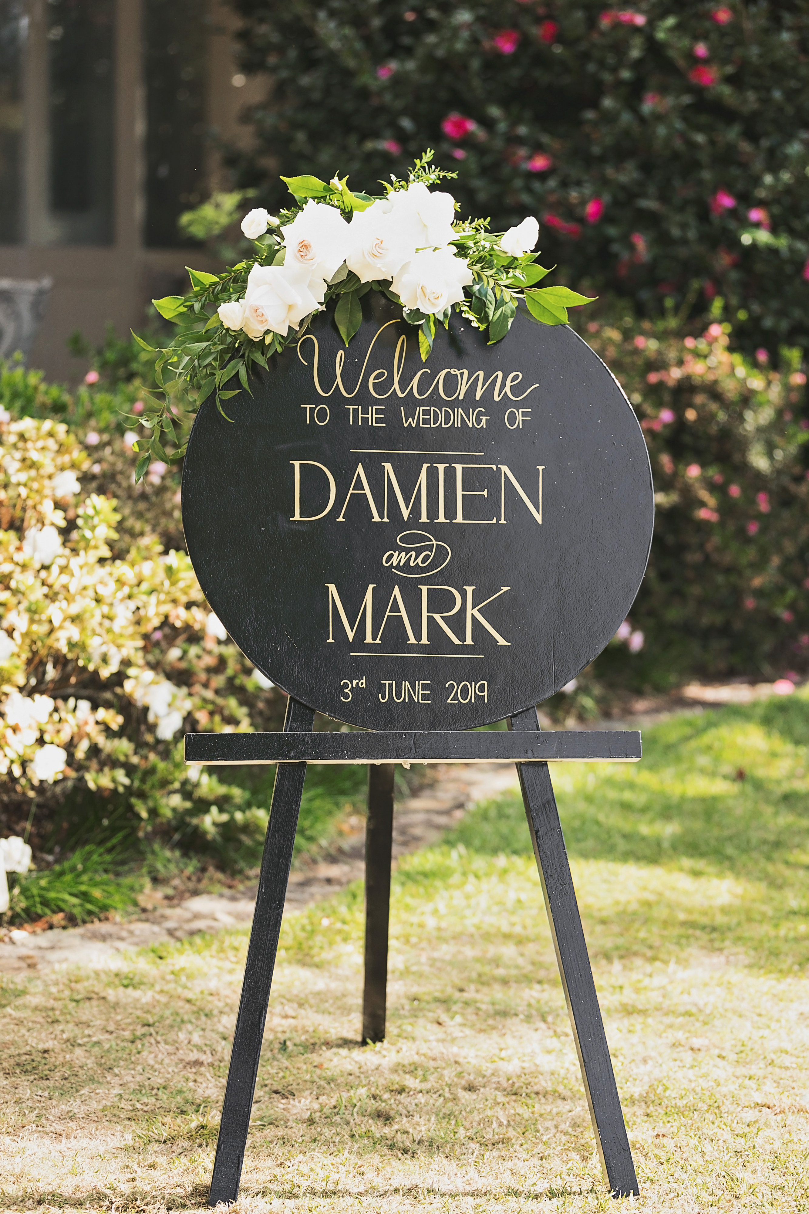 white entry sign floral