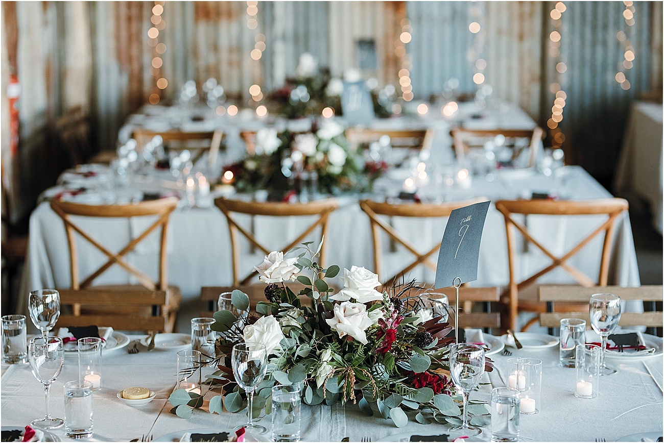 Low lying rustic reception centrepieces