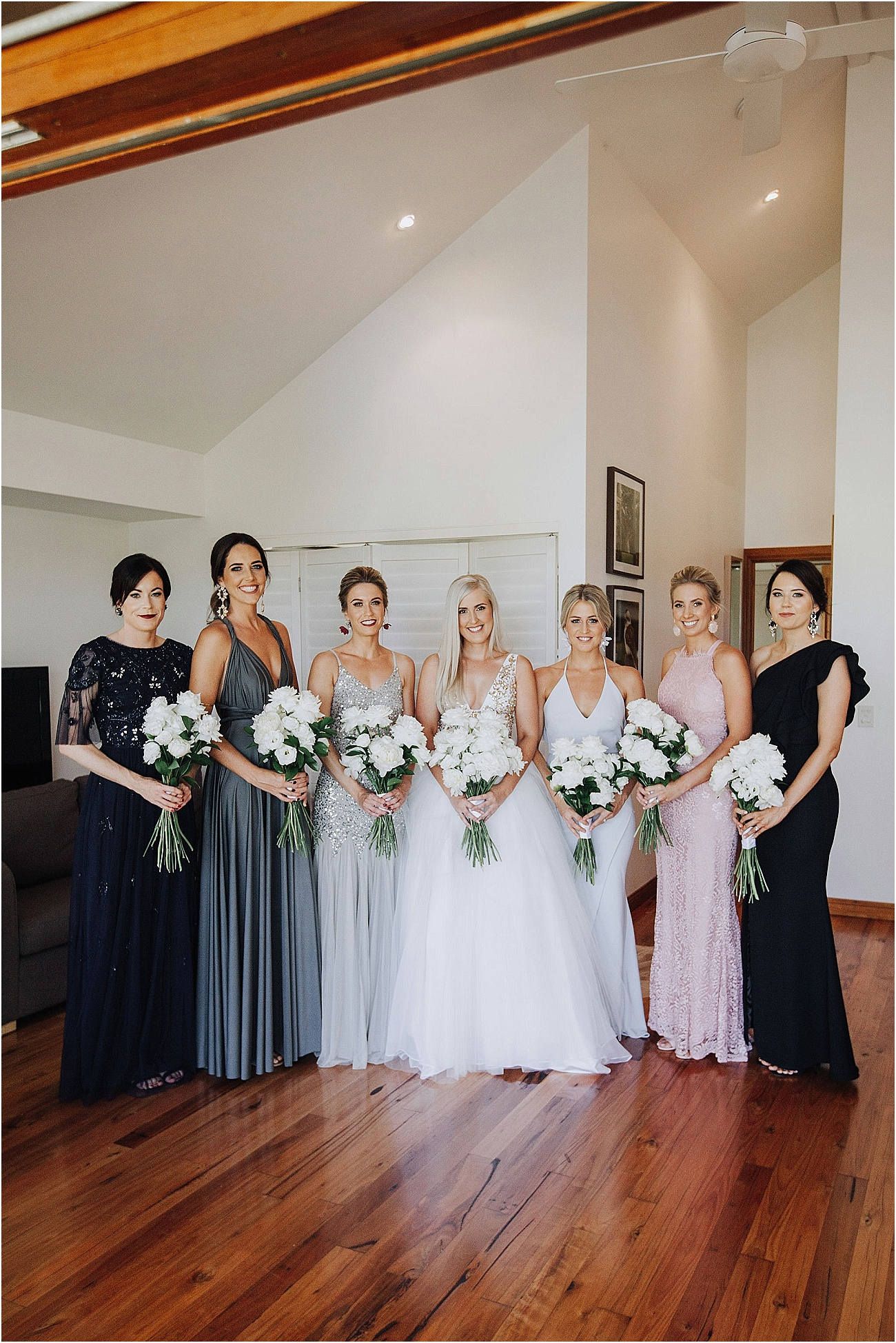 Modern white wedding bouquets featuring roses