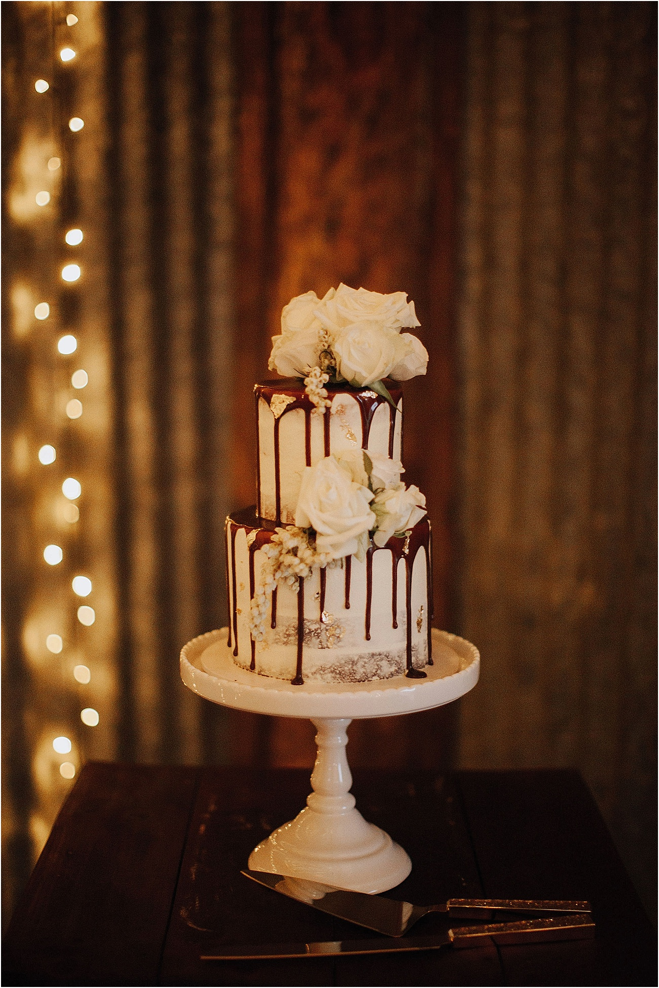 Wedding cake featuring white rose blooms
