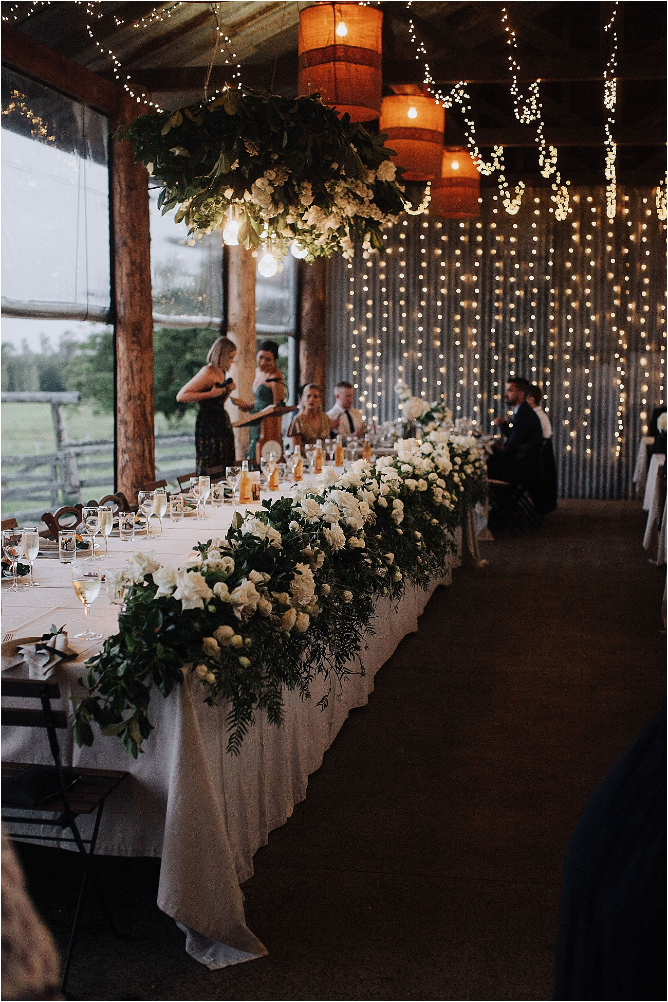Lush Bridal table garland featuring white blooms and foliage