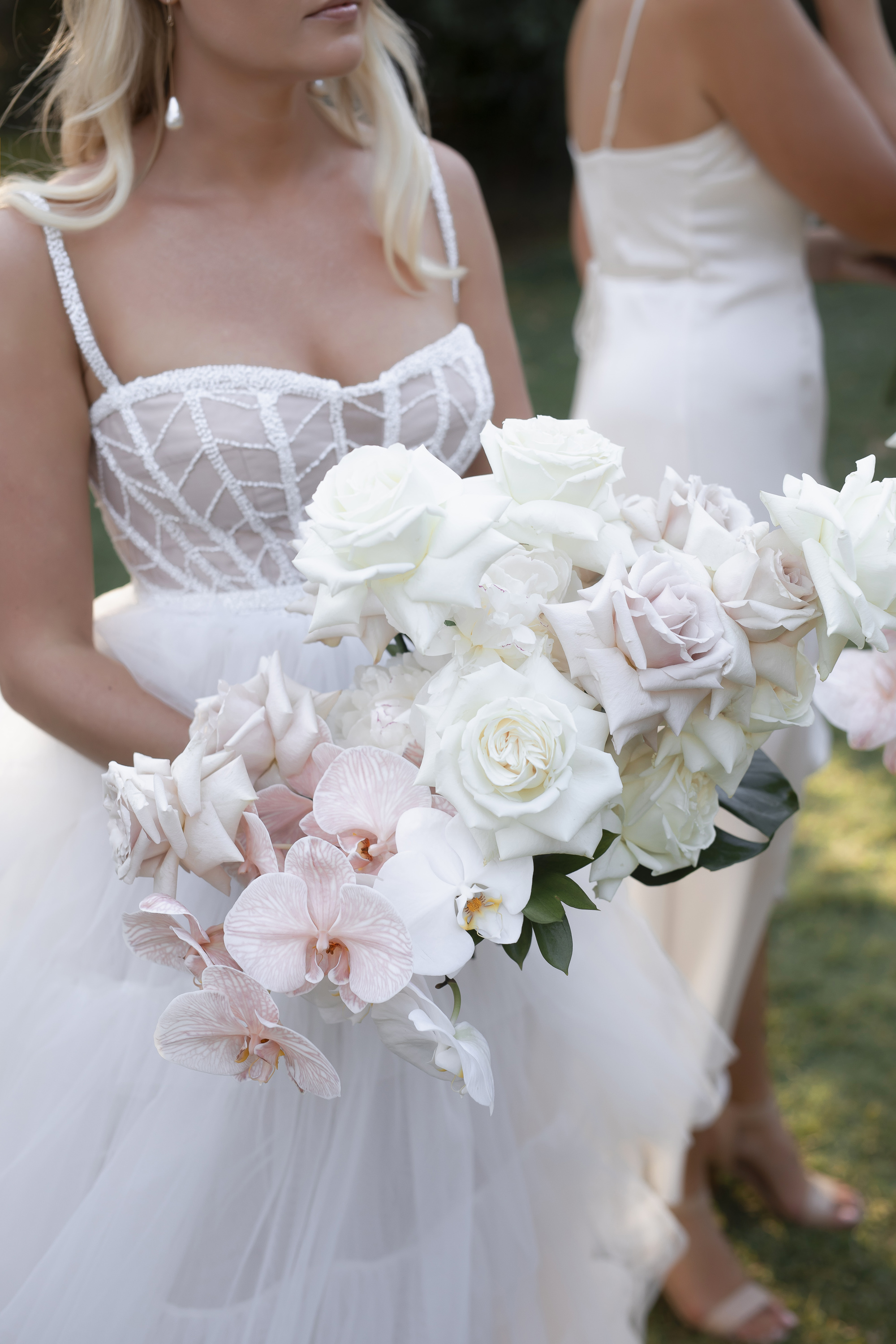 Antique pink roses, white roses and ivory roses with phally orchids