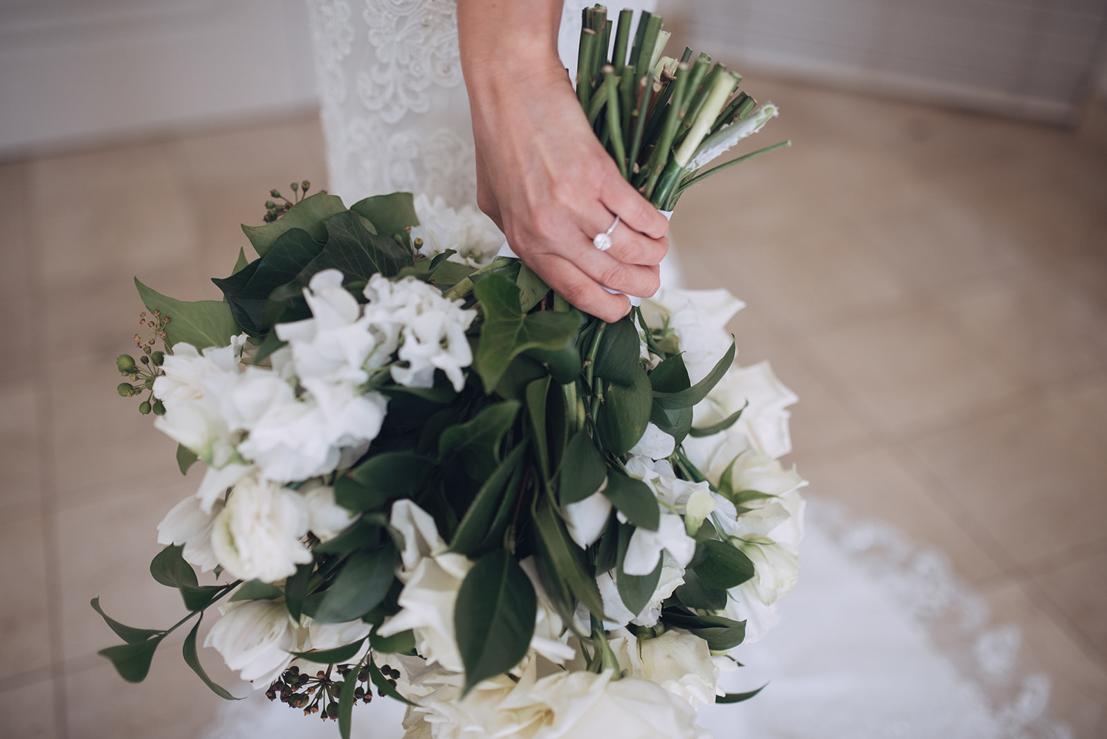 Romantic crisp white and lush green wedding bouquet