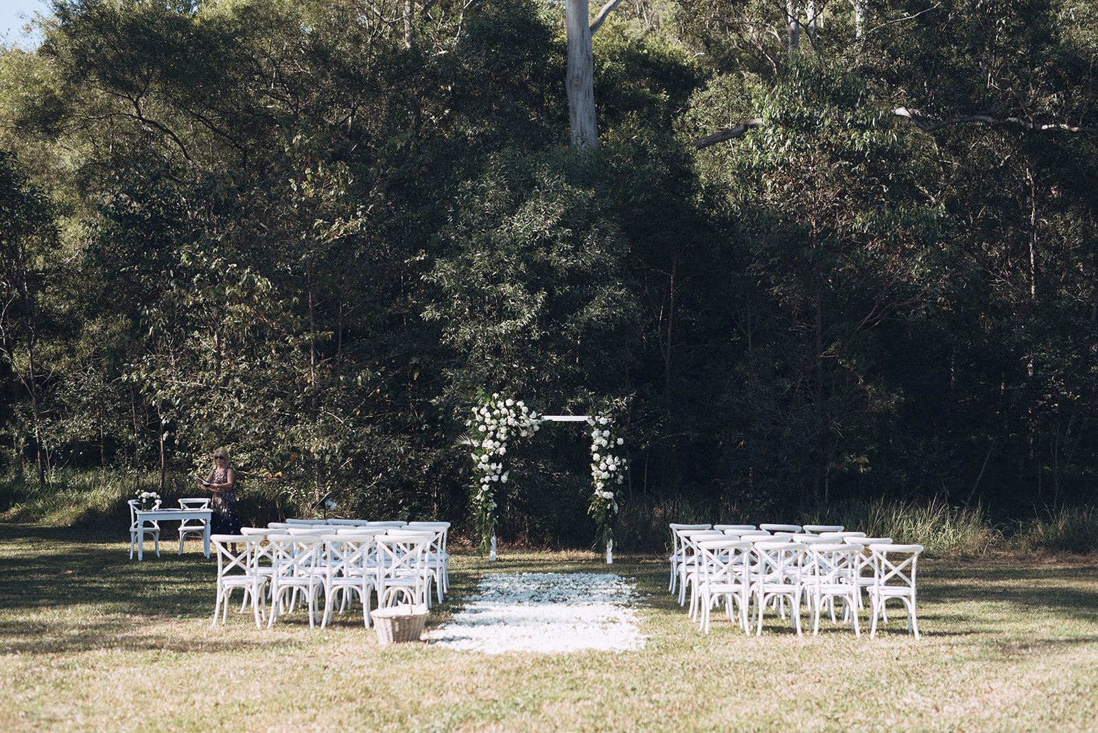 Modern white wedding arbour featuring white blooms