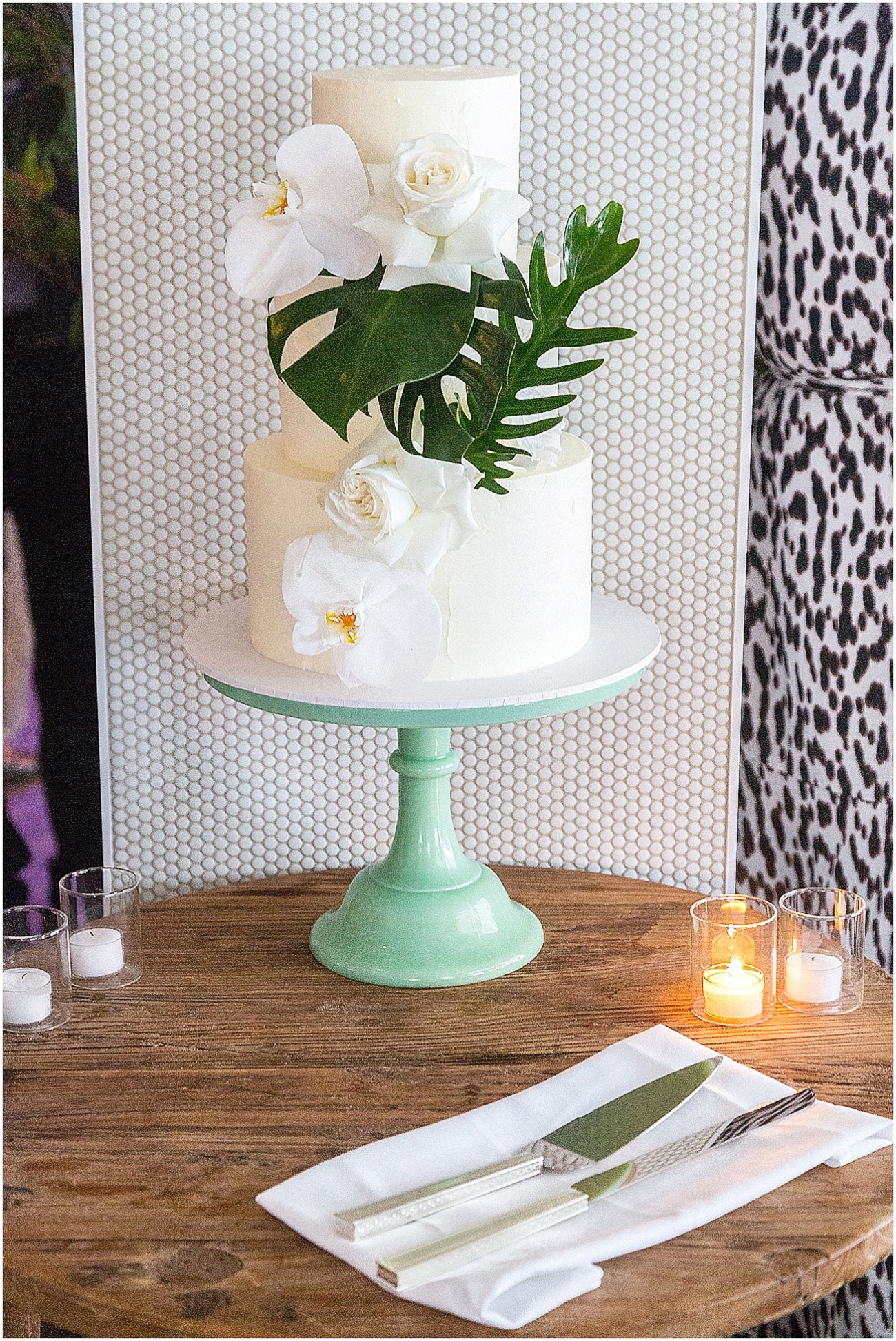 Wedding cake featuring orchids roses and tropical leaves