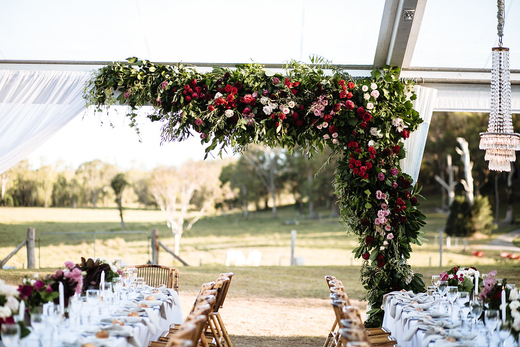 Large lush floral installation in rich tones