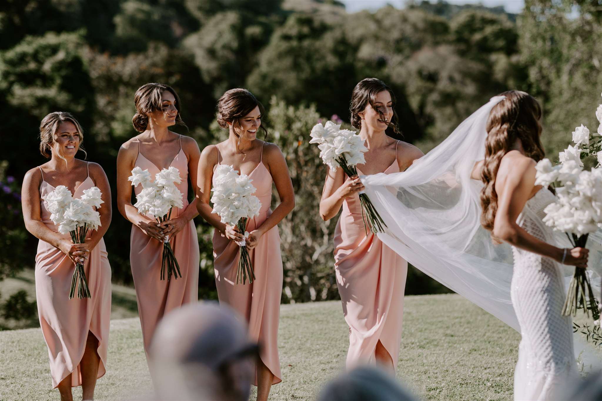 Modern Bridesmaids bouquets of white roses