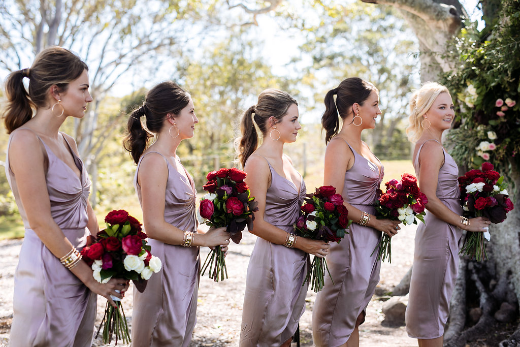 Modern wedding bouquets featuring red roses