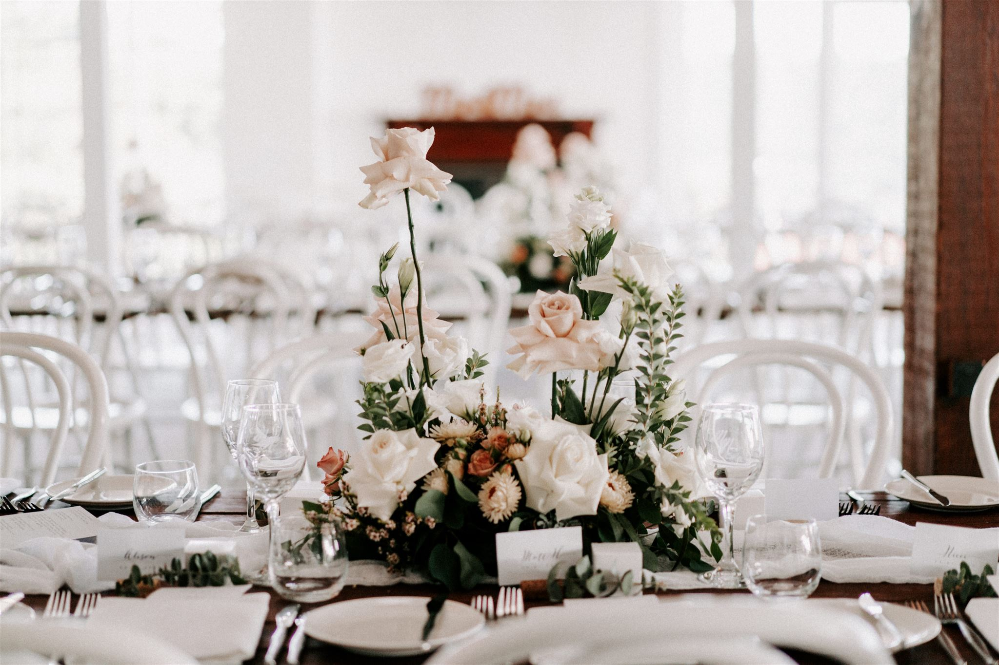 Modern table centrepieces featuring pastel toned blooms