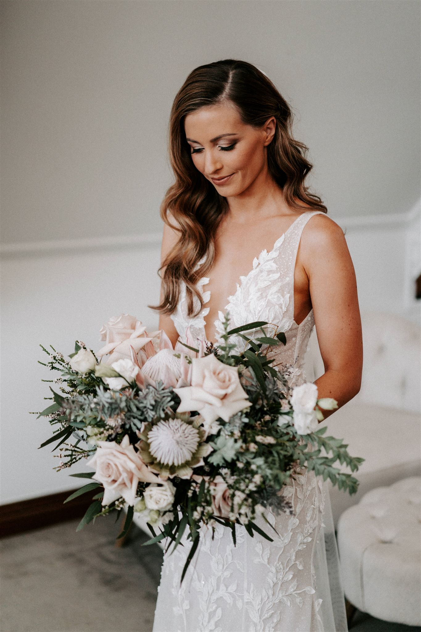 Romantic rustic wedding bouquet featuring roses and king proteas