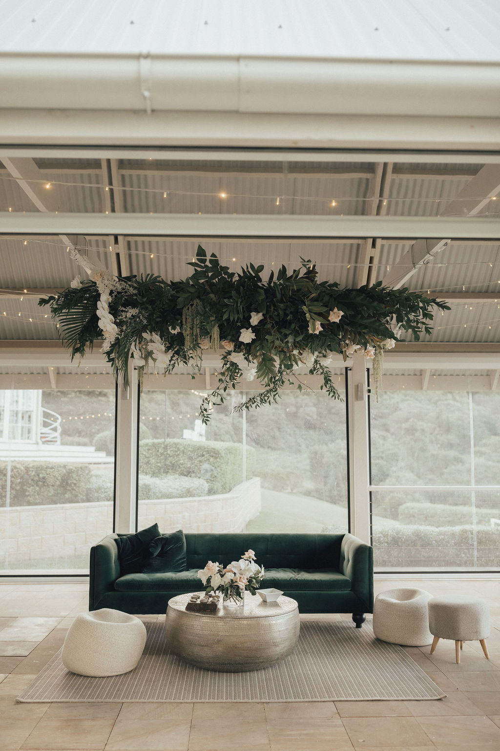 Hanging installation with tropical greenery and orchids