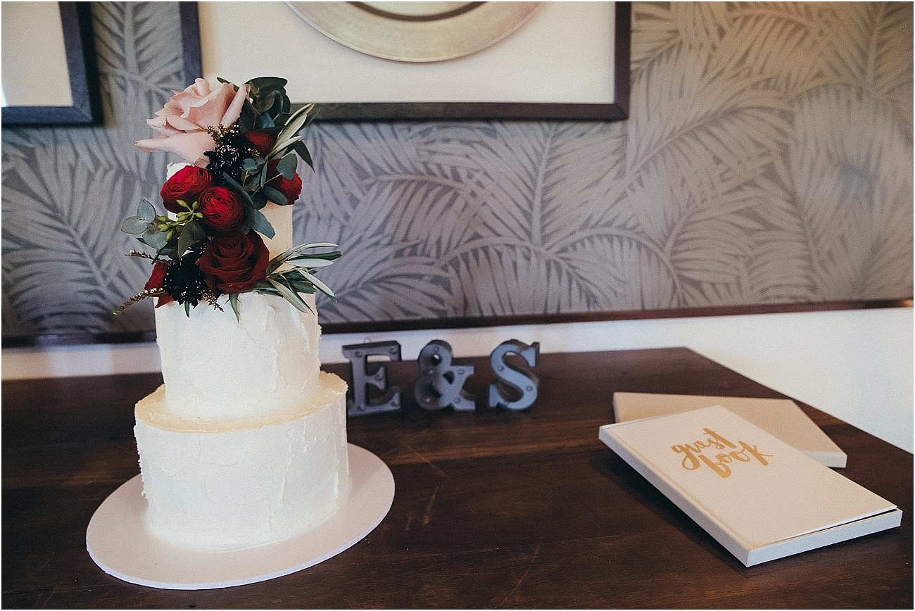 Rich toned wedding cake floral feature